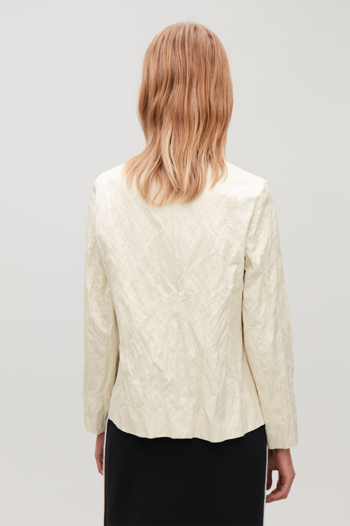 Model side image of Cos crushed long-sleeved top in white
