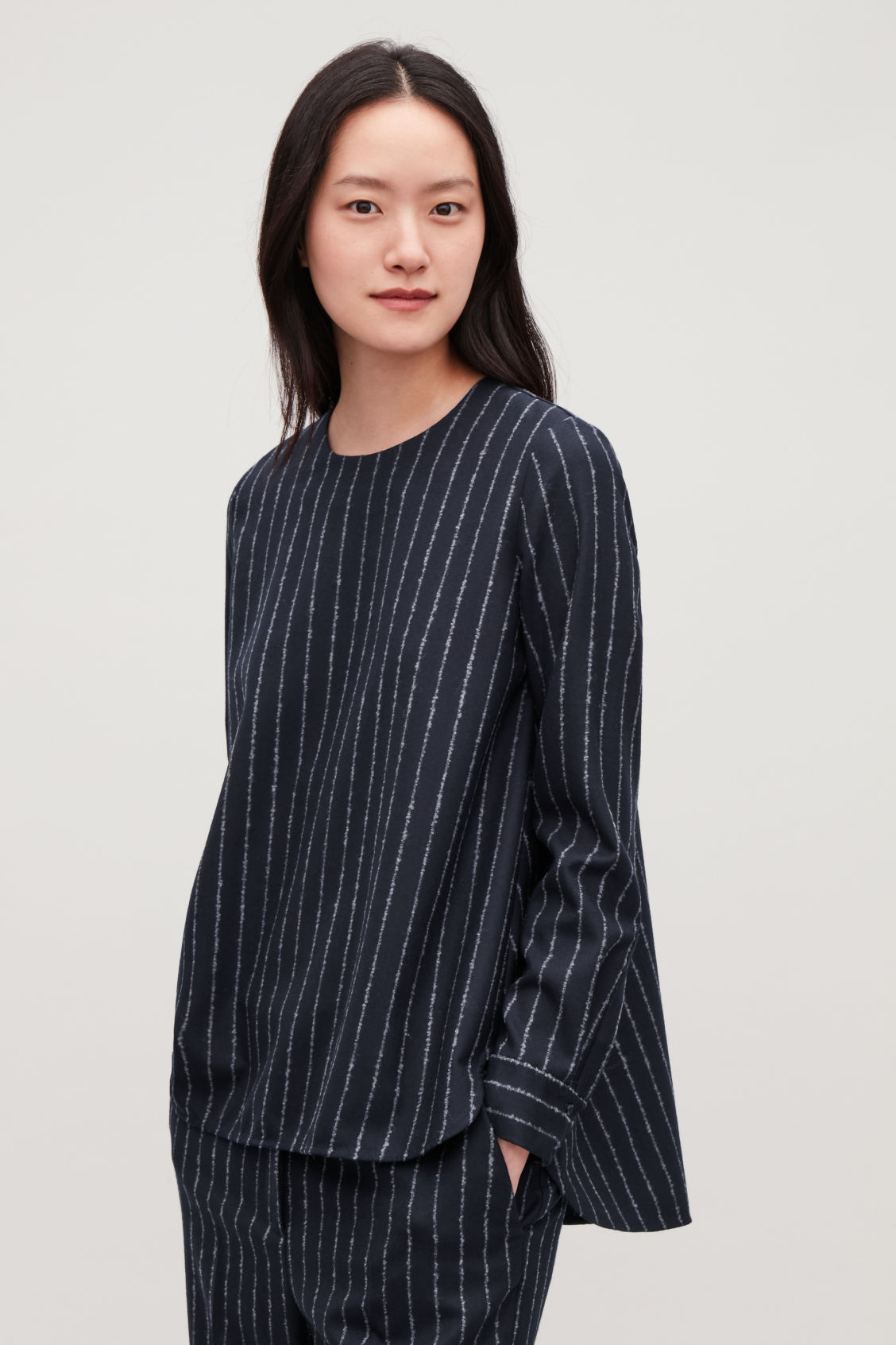 Model side image of Cos boucle-pinstiped wool blouse in blue