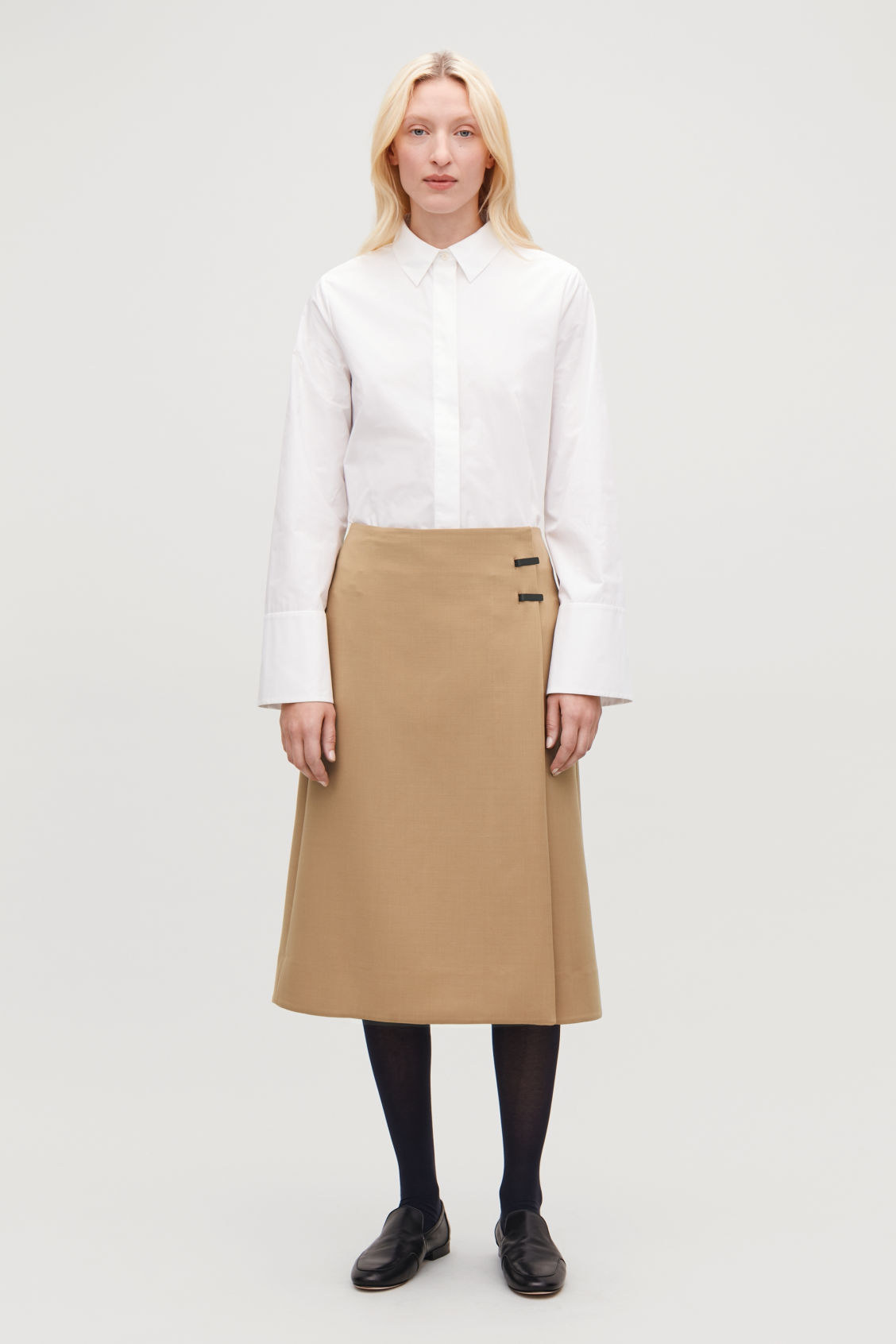 Model front image of Cos clip-buckle wrap skirt in beige