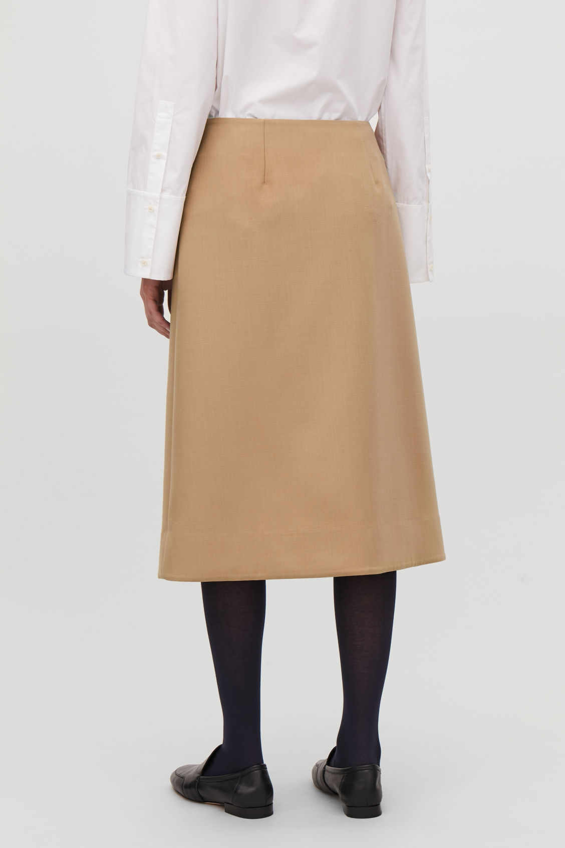 Model side image of Cos clip-buckle wrap skirt in beige