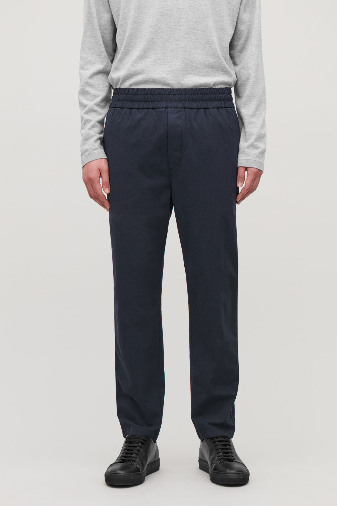 Model side image of Cos relaxed elastic-waist trousers in blue
