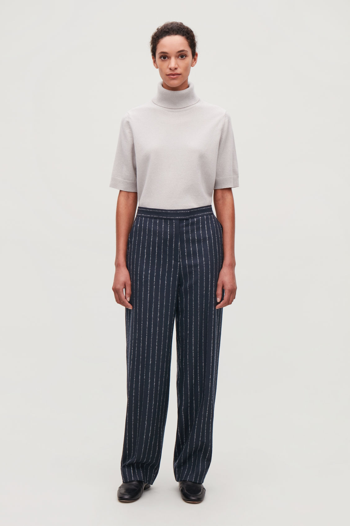 Model front image of Cos pinstriped wide wool trousers in blue
