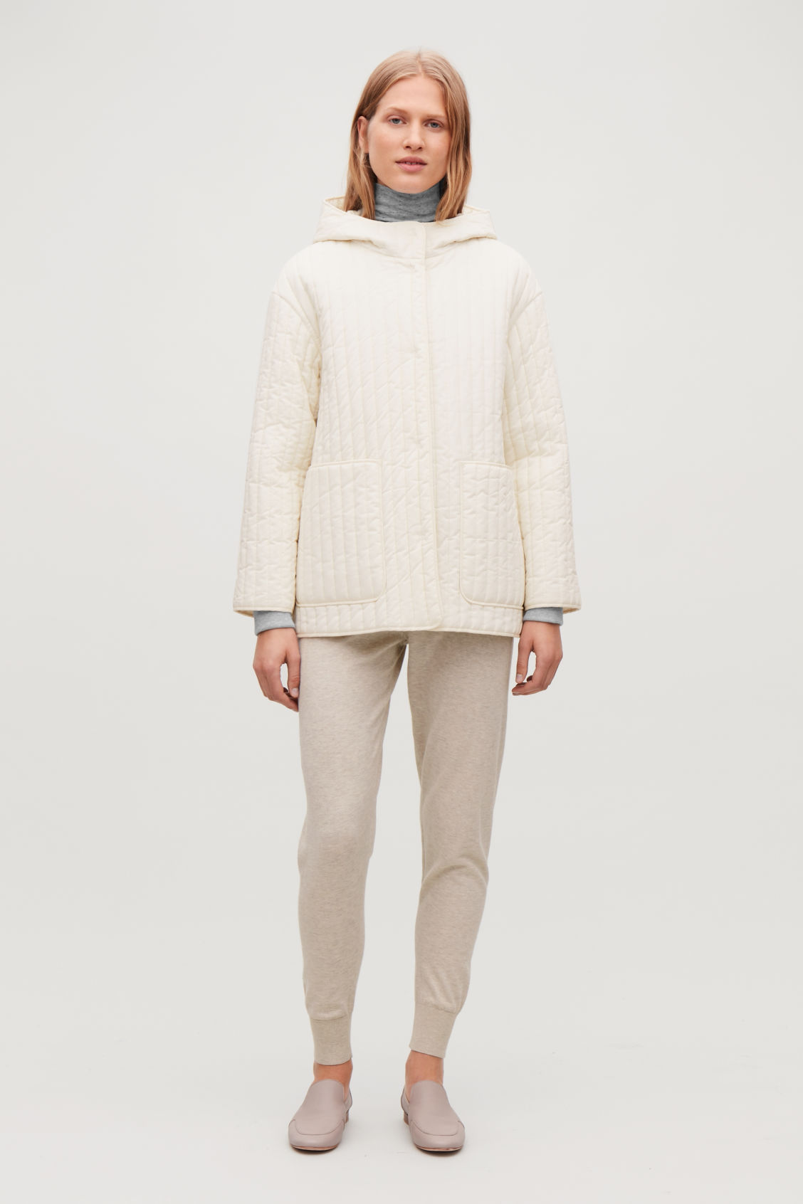 Model side image of Cos hooded padded cotton jacket  in white