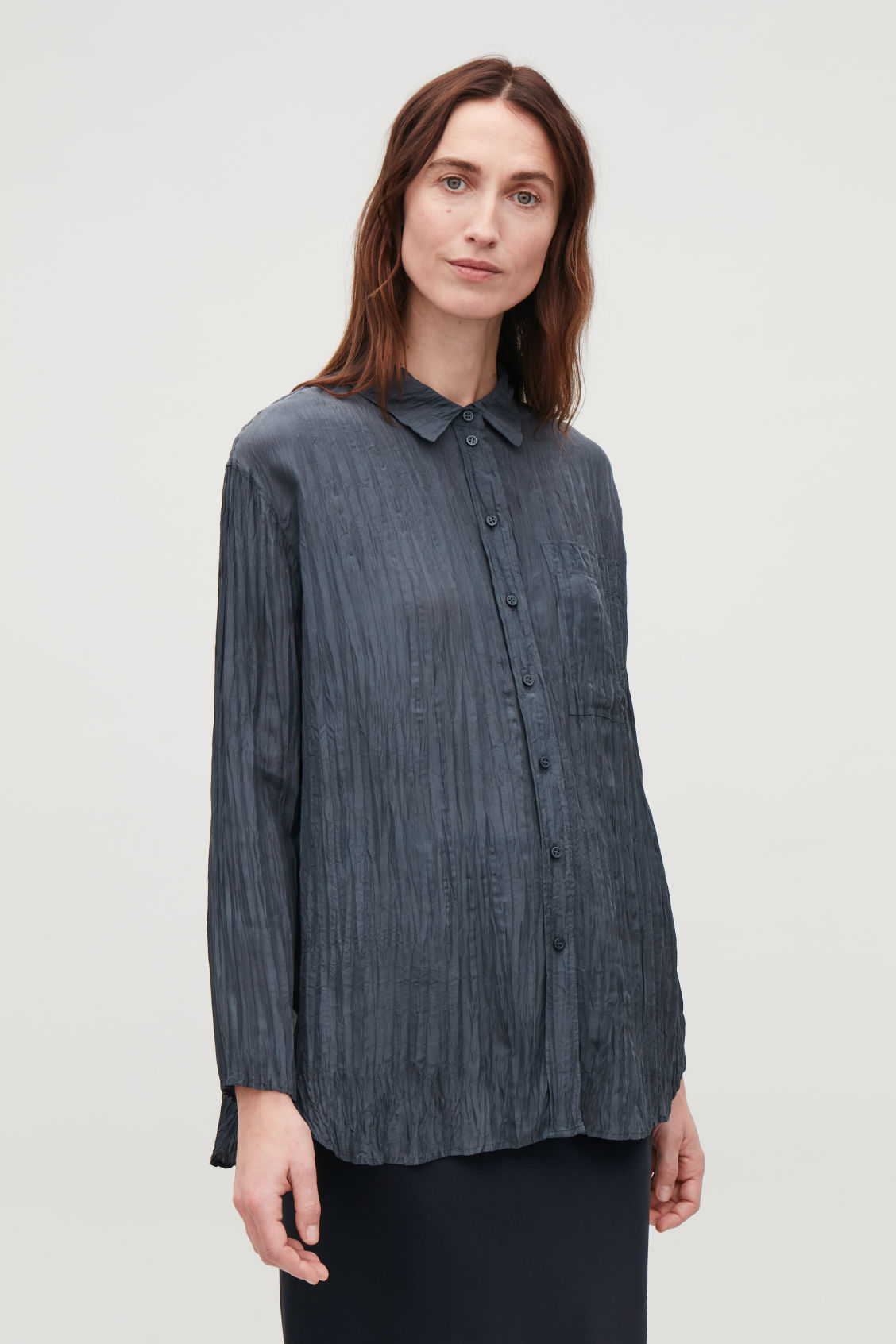 Model side image of Cos crinkled silk shirt in blue