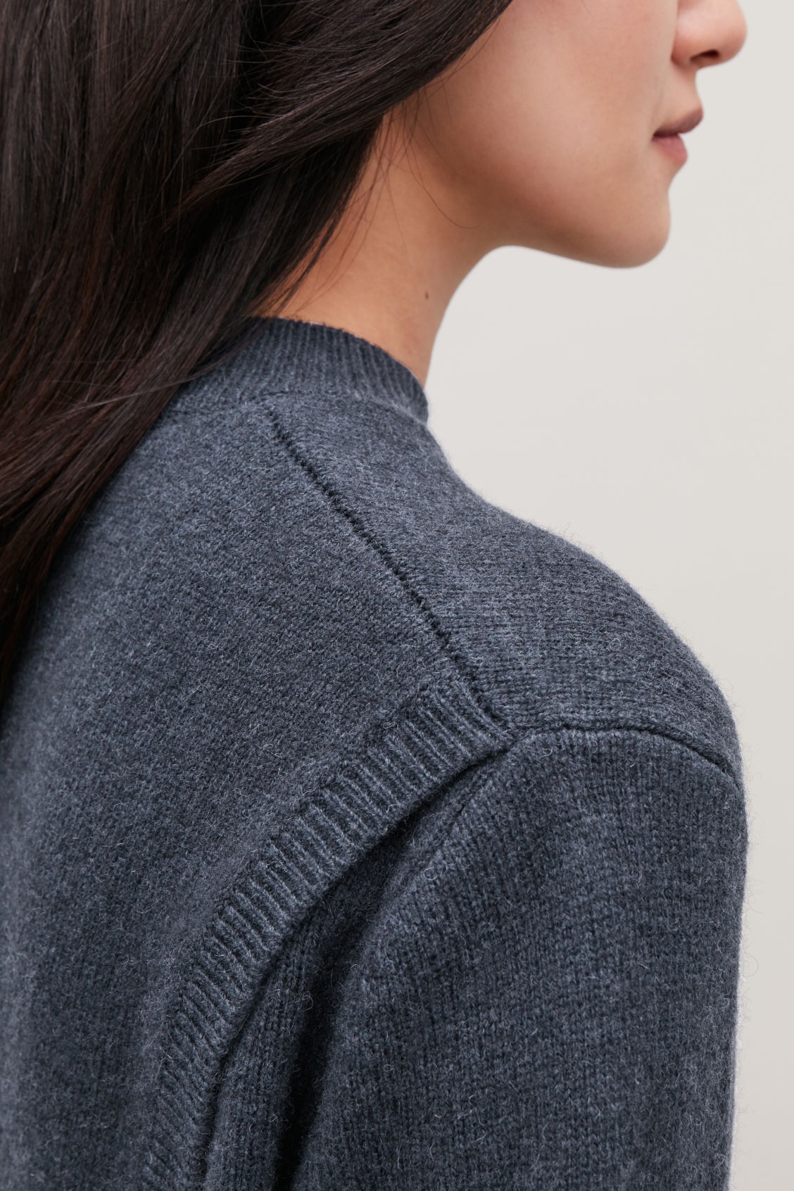 Model side image of Cos wrap-over lambswool jumper in blue
