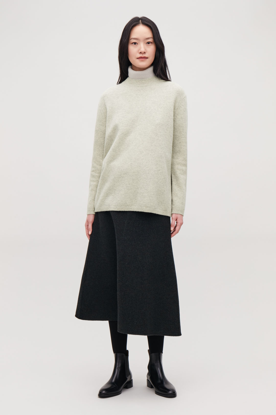 Model front image of Cos wrap-over lambswool jumper in green