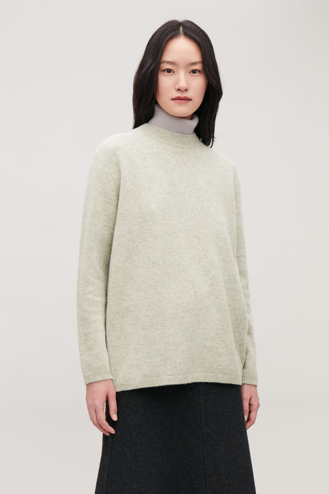 Model side image of Cos wrap-over lambswool jumper in green