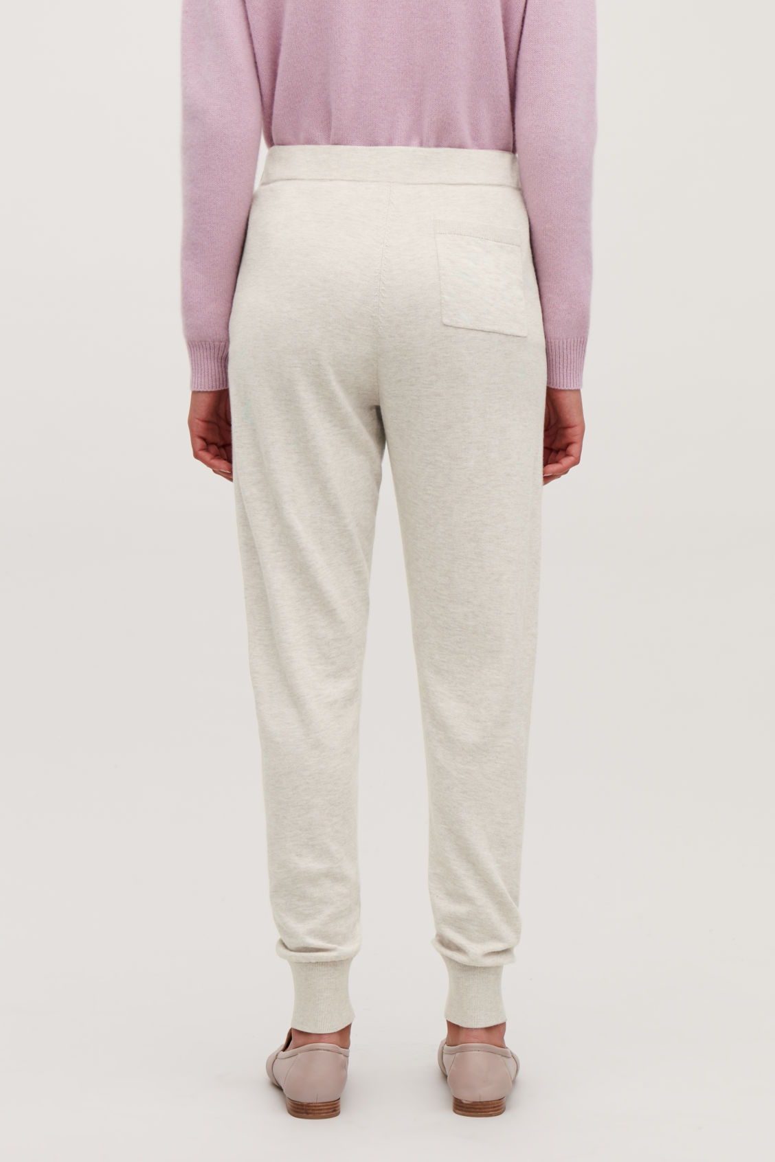 Model side image of Cos cotton-cashmere knit trousers in beige