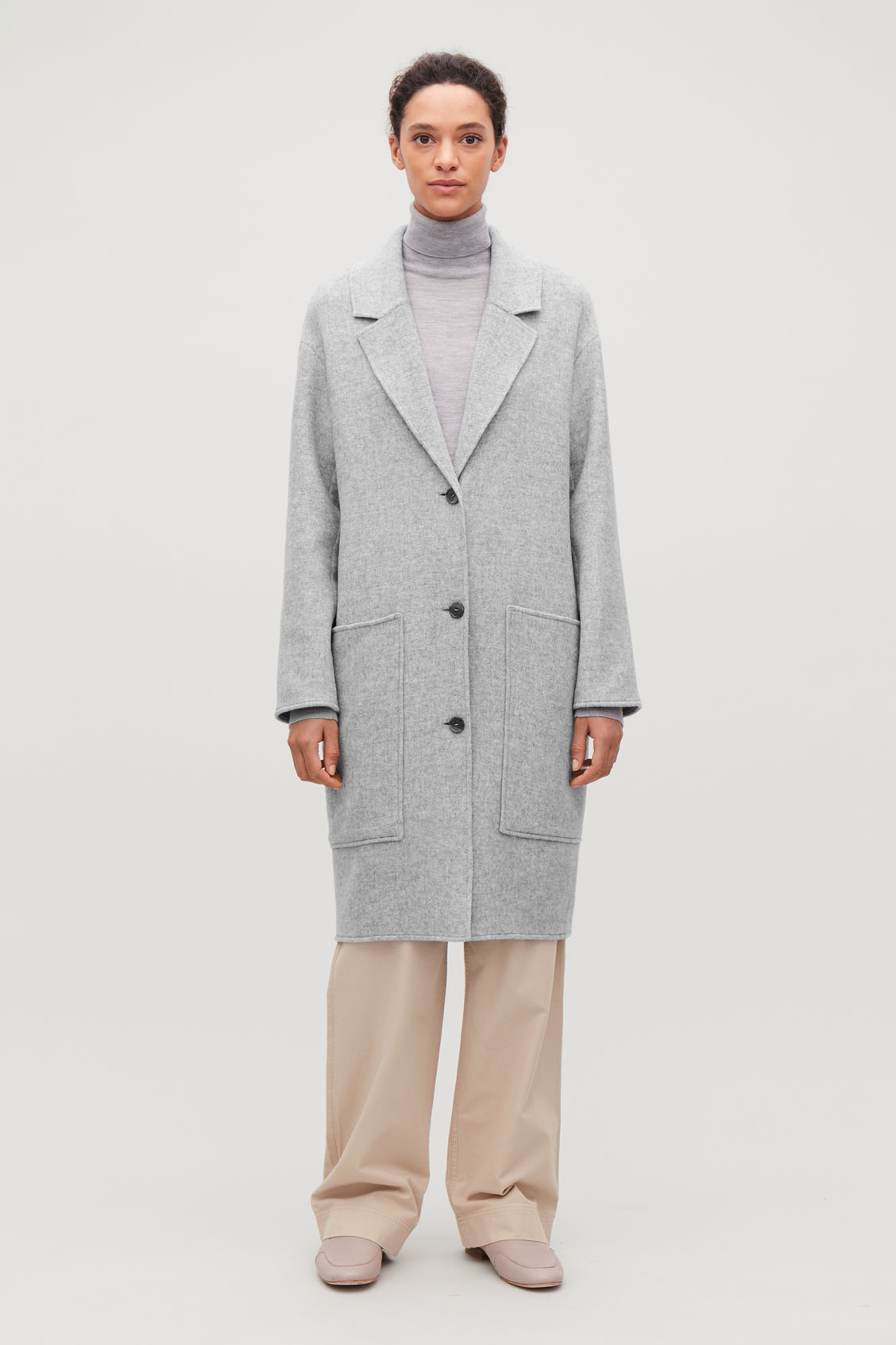 Model front image of Cos wool coat with large pockets in grey