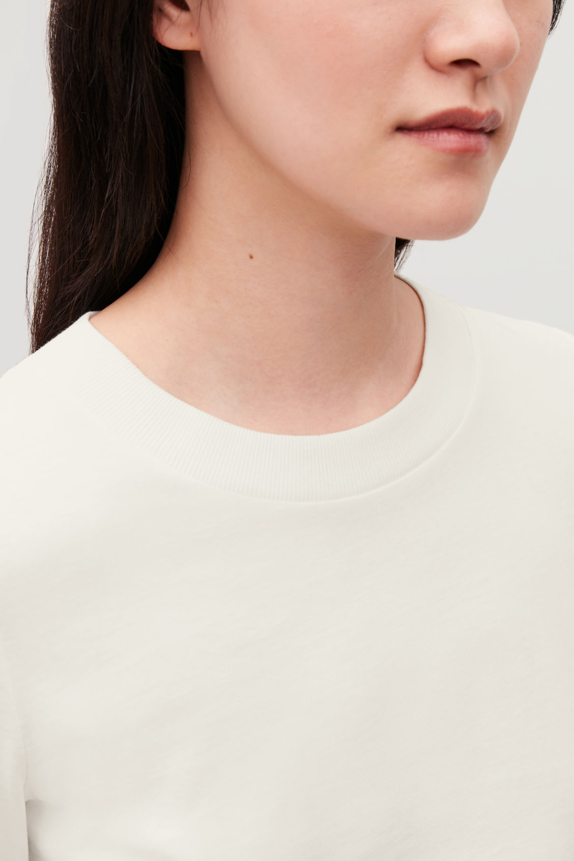 Model side image of Cos jersey long-sleeved top  in beige