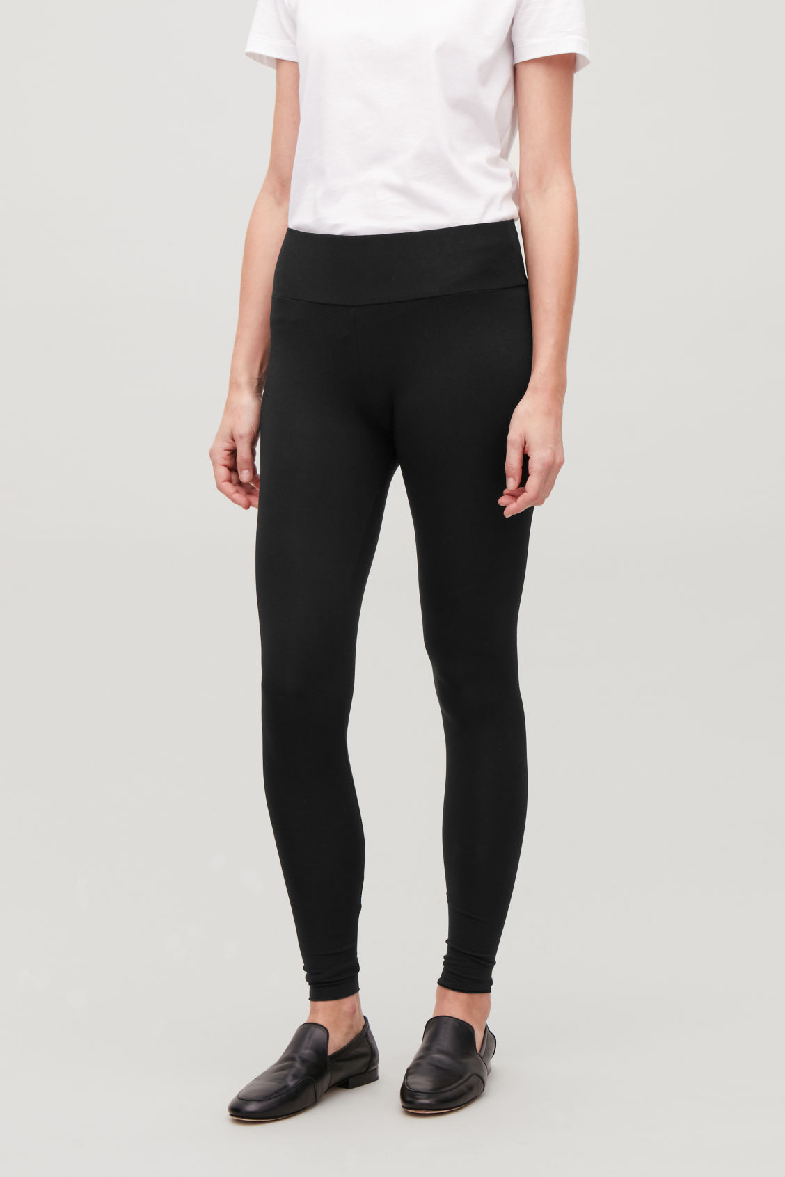 Model side image of Cos slim jersey leggings in black
