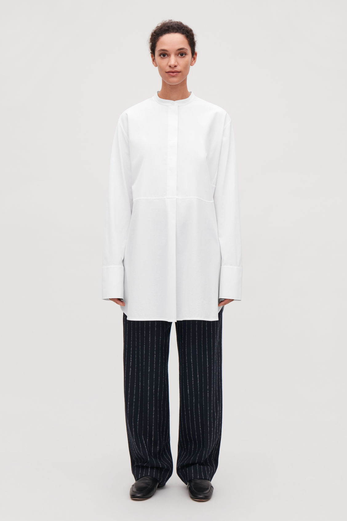 Model front image of Cos long woven-jersey mix shirt in white