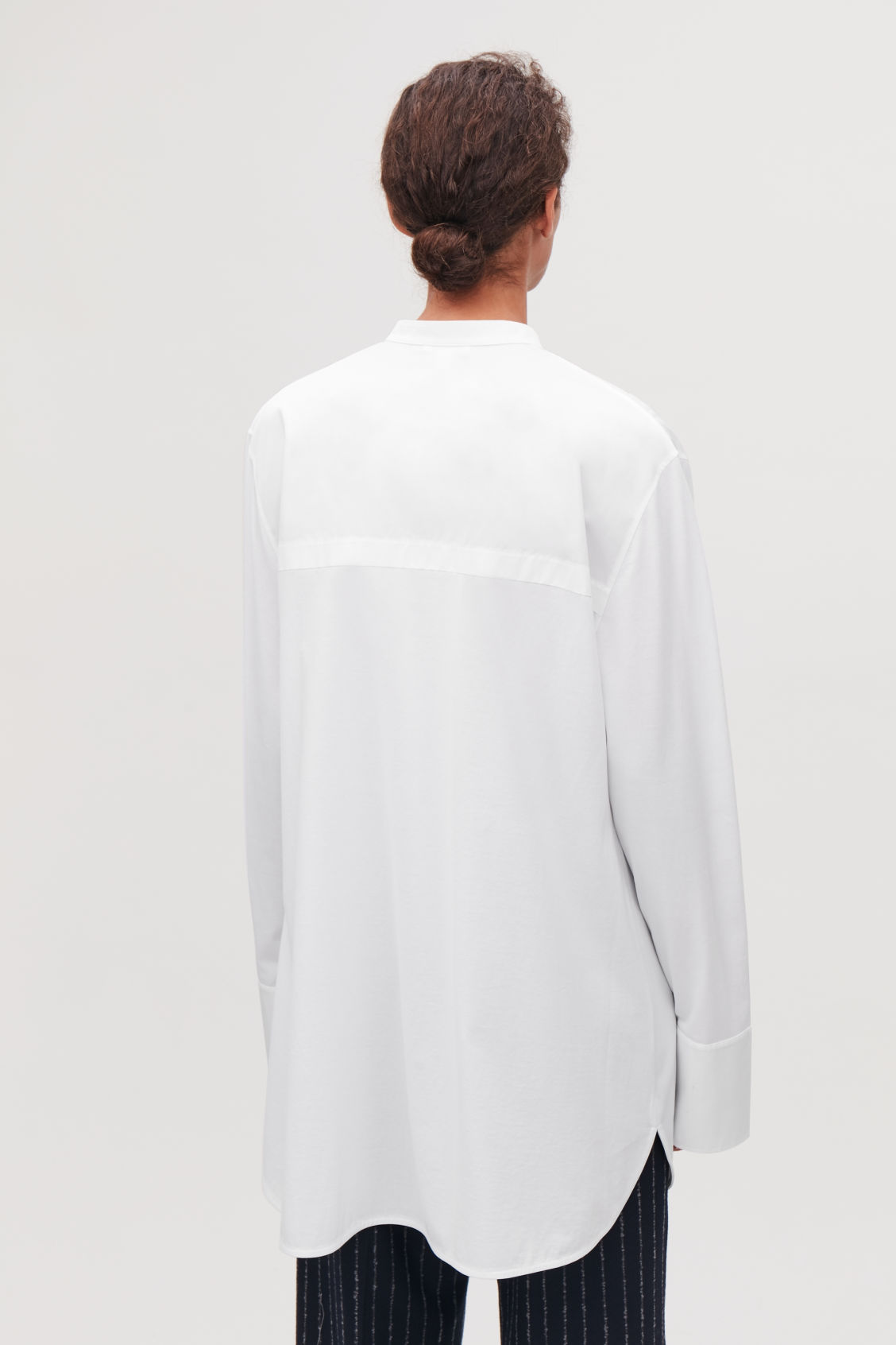 Model side image of Cos long woven-jersey mix shirt in white