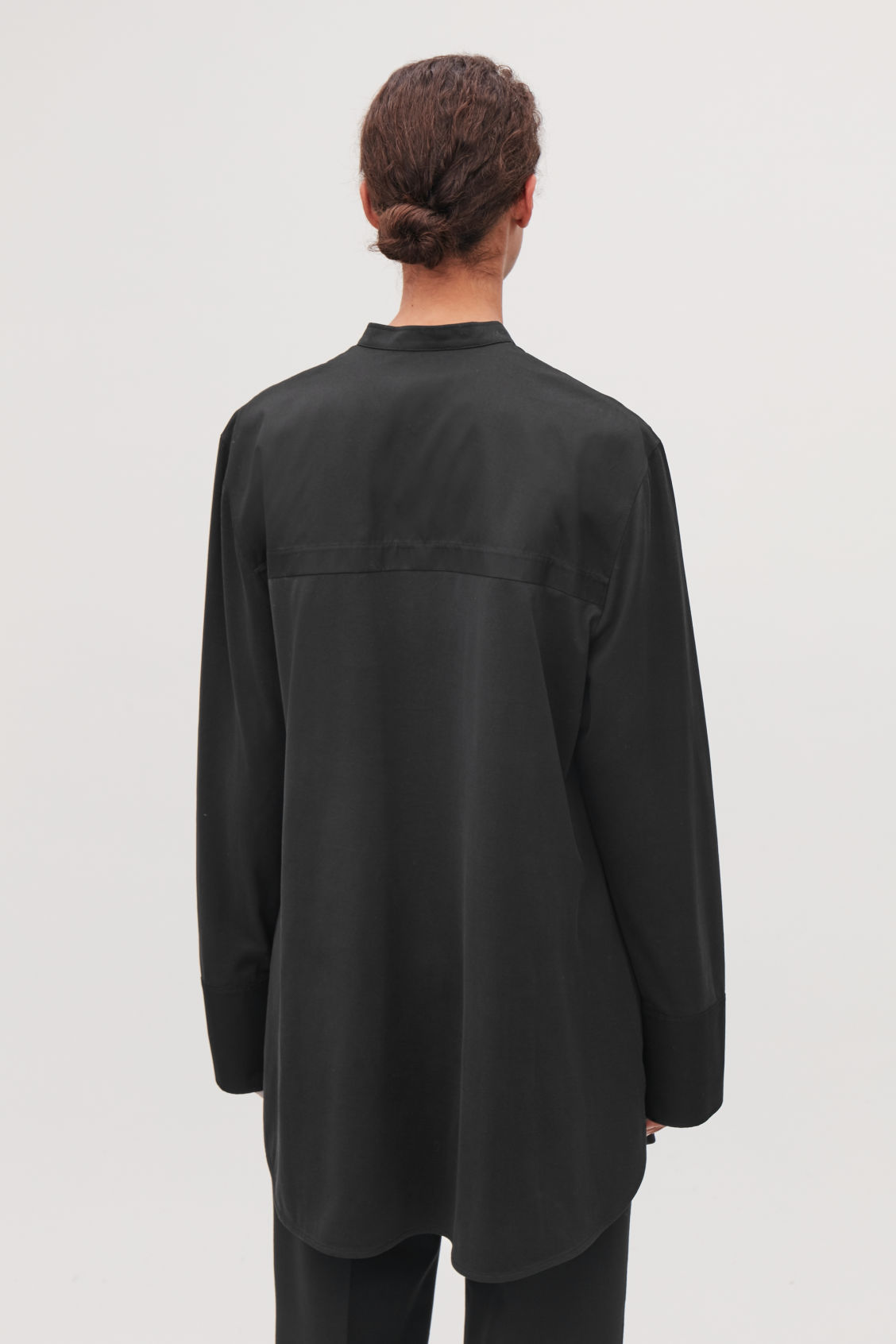 Model side image of Cos long woven-jersey mix shirt in black