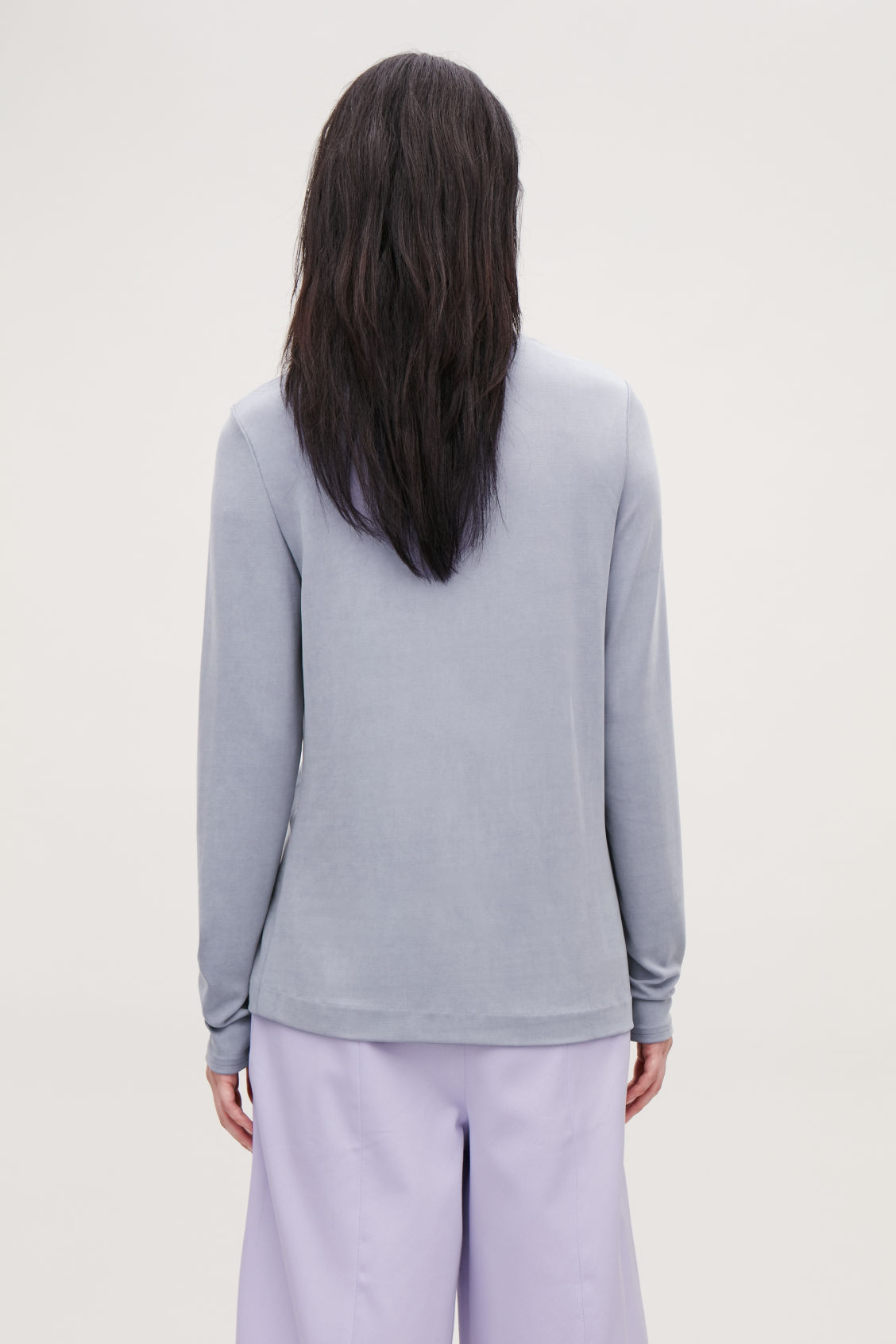 Model side image of Cos cupro roll-neck top in purple