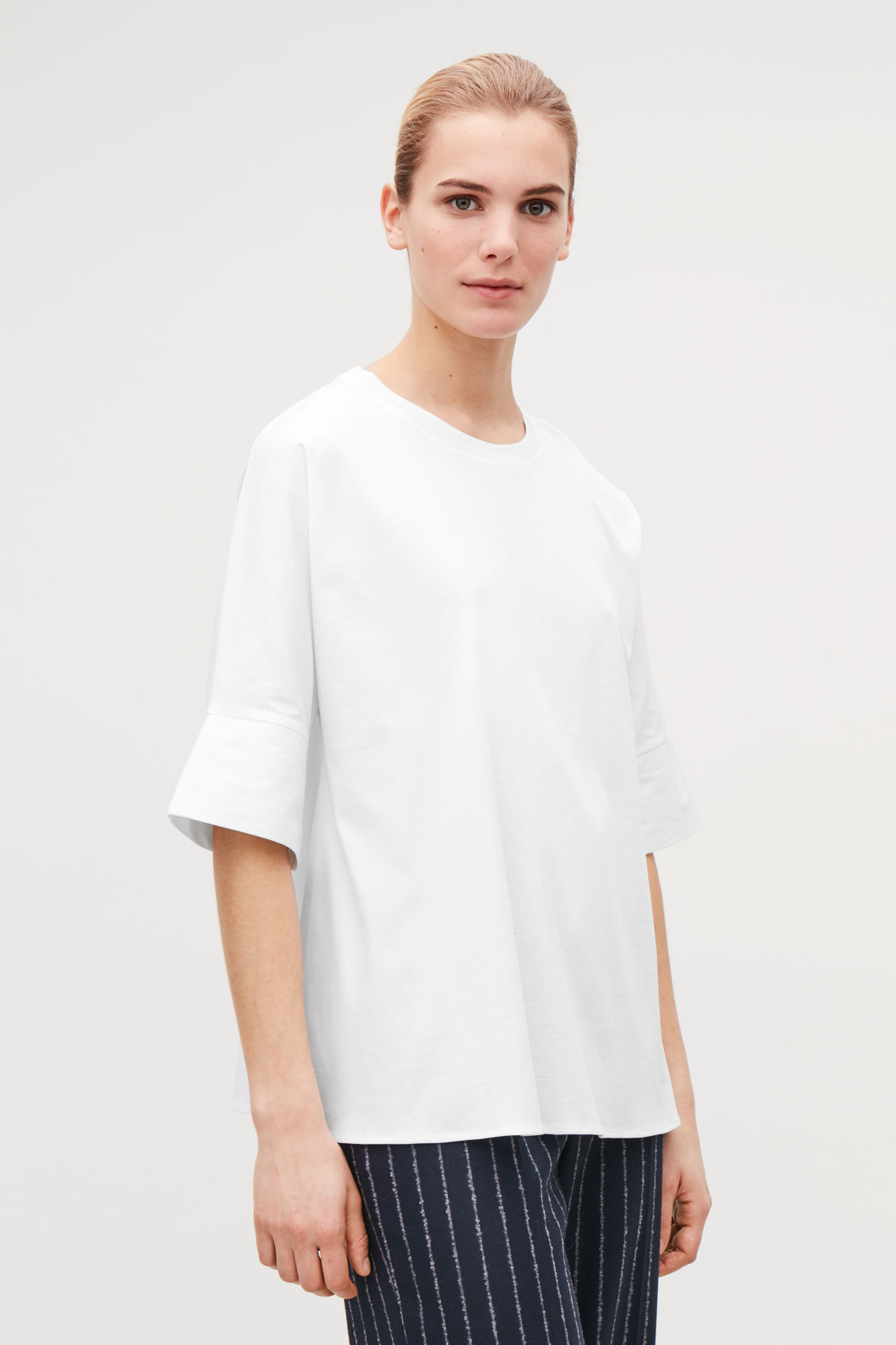 Model side image of Cos kimono-sleeved a-line top in white