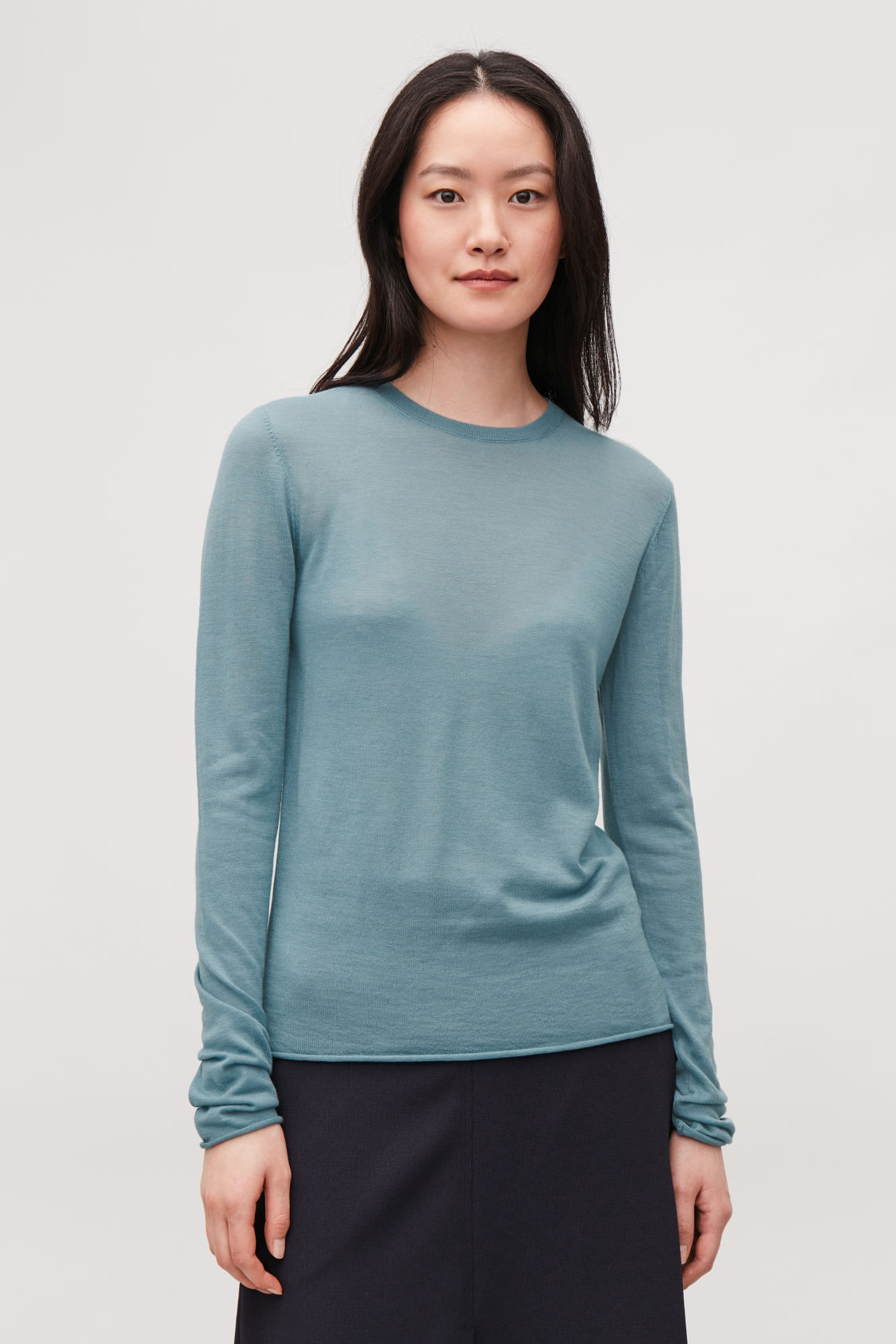 Model side image of Cos merino round-neck jumper in turquoise