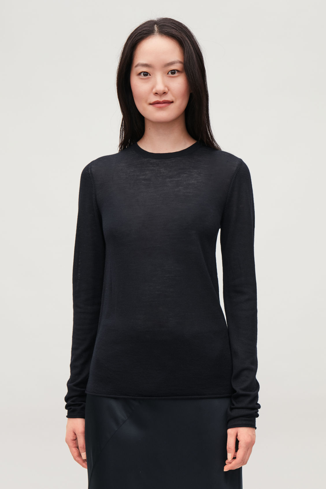 Model side image of Cos merino round-neck jumper in blue