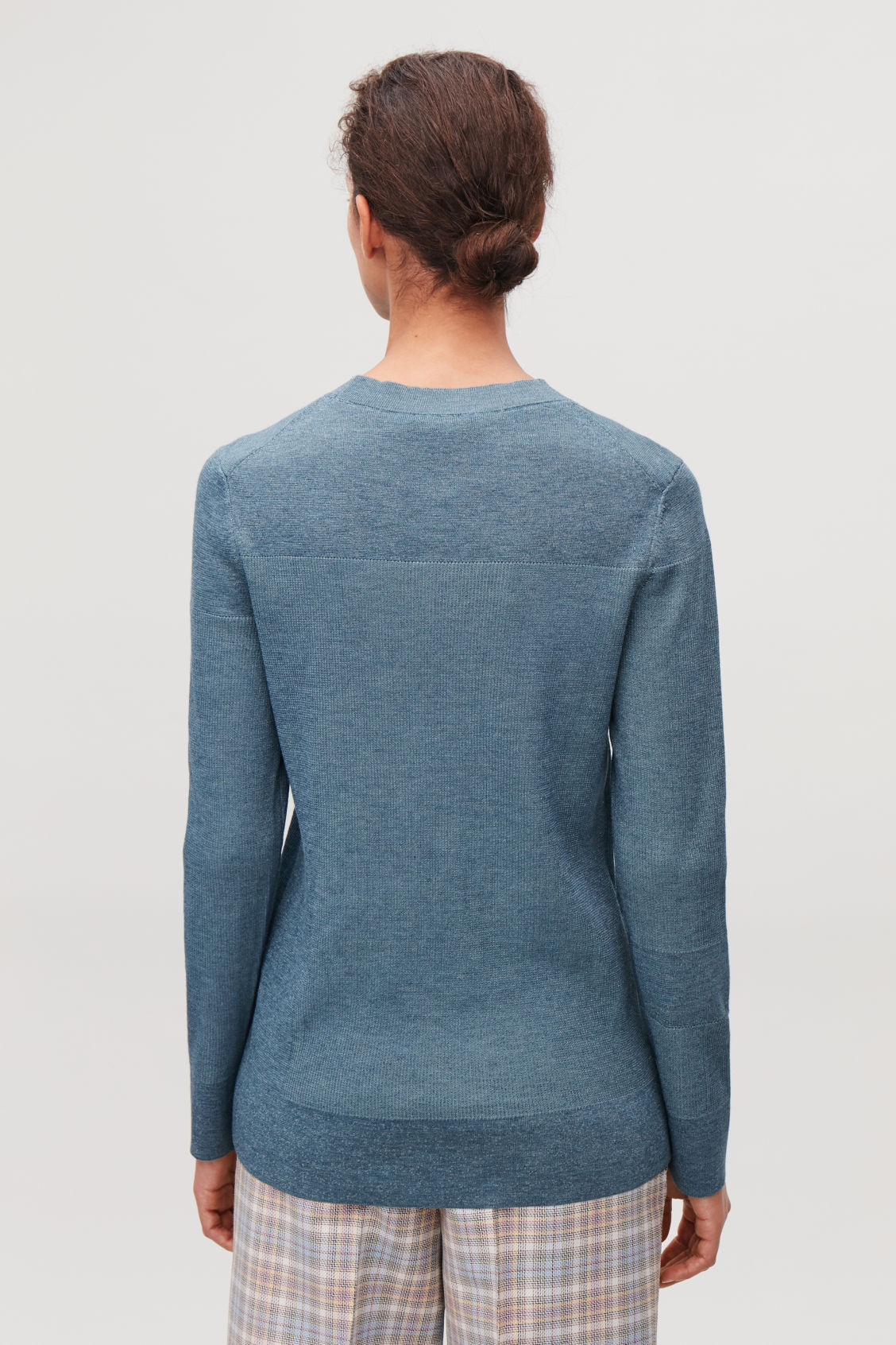 Model side image of Cos mix-rib jumper in blue