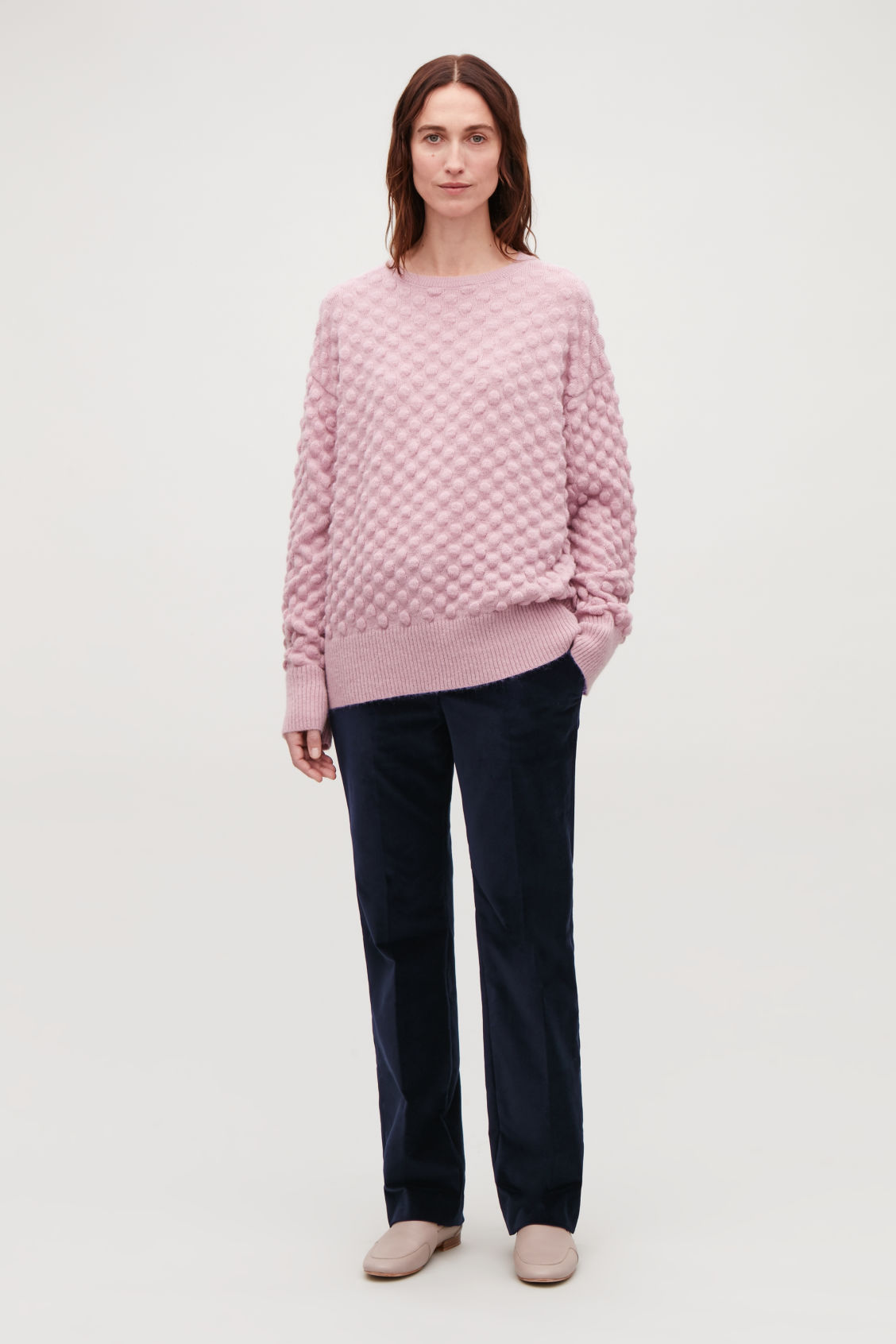 Model side image of Cos bobble stitch jumper in pink