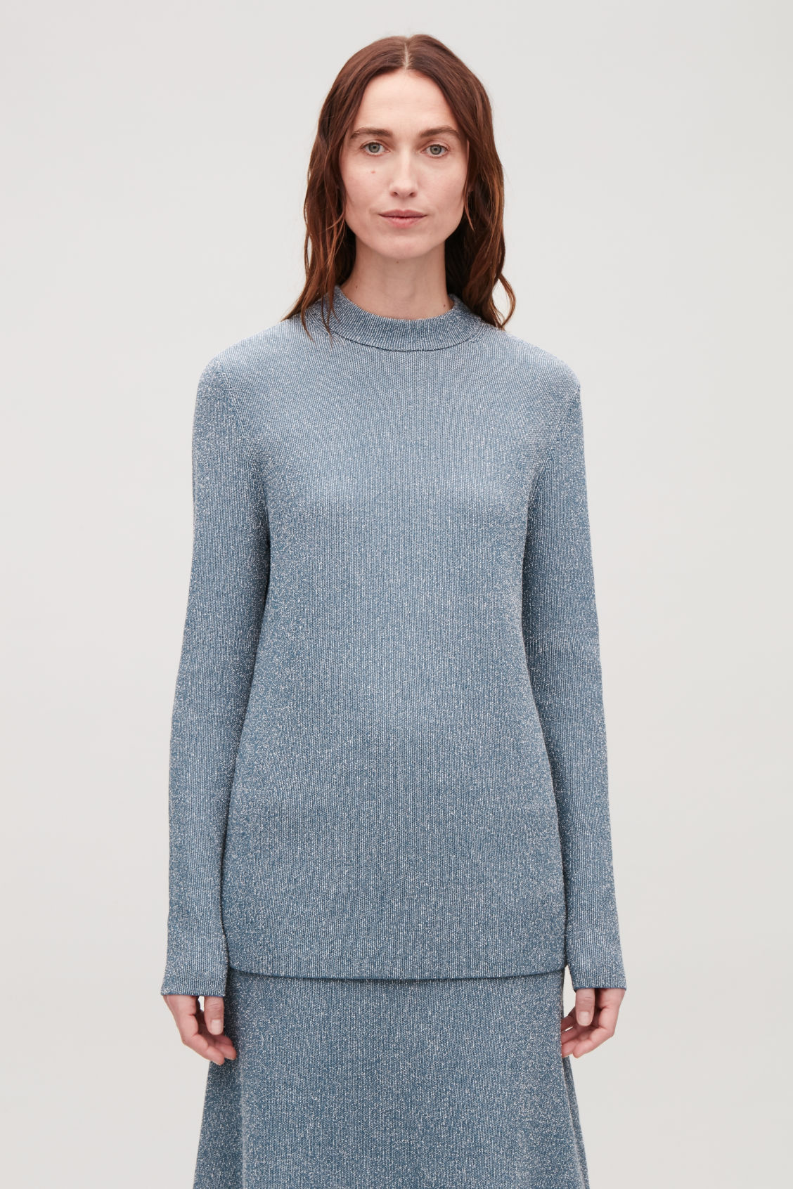 Model side image of Cos drop-needle stitch knit jumper in blue