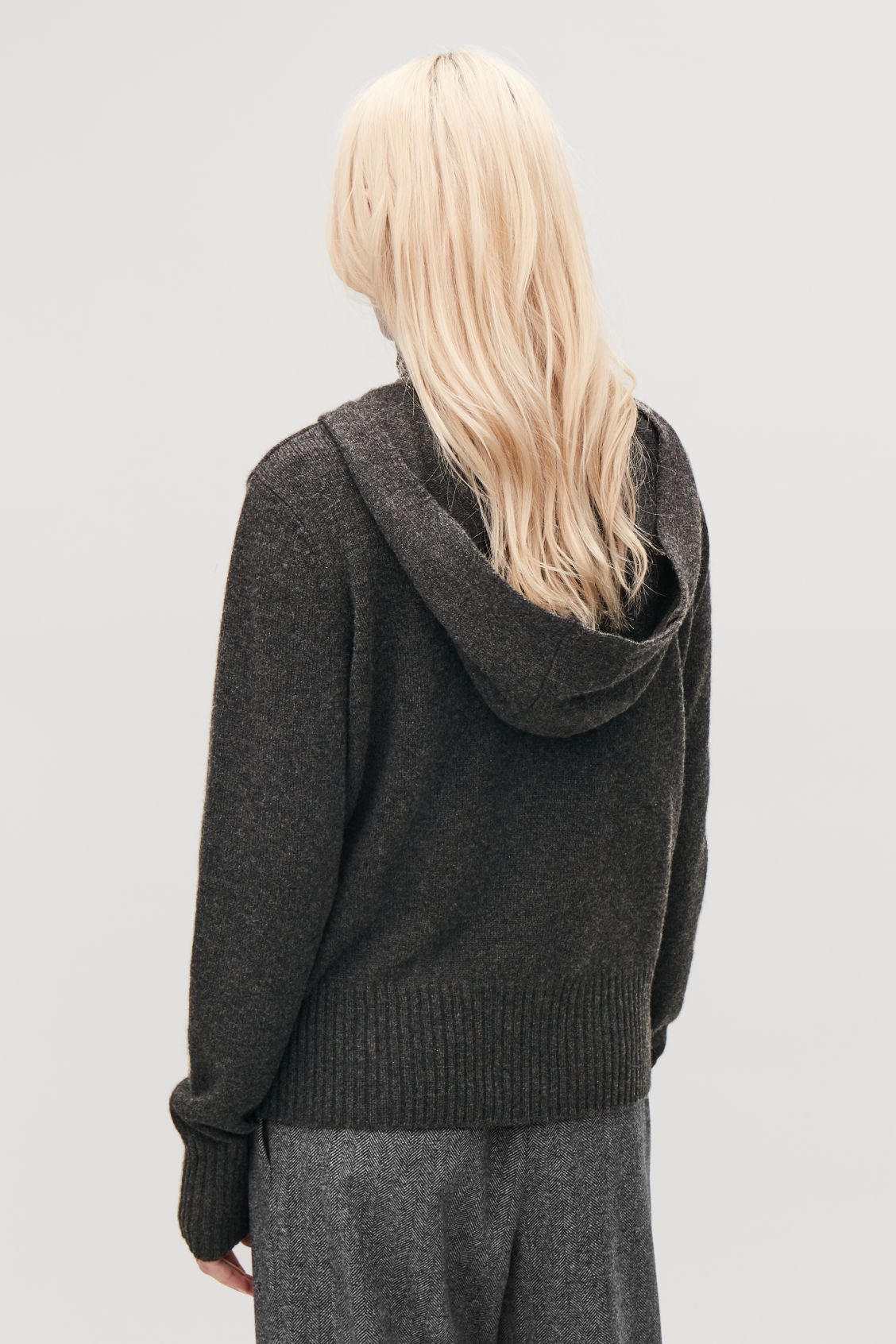 Model side image of Cos cashmere hooded top in grey