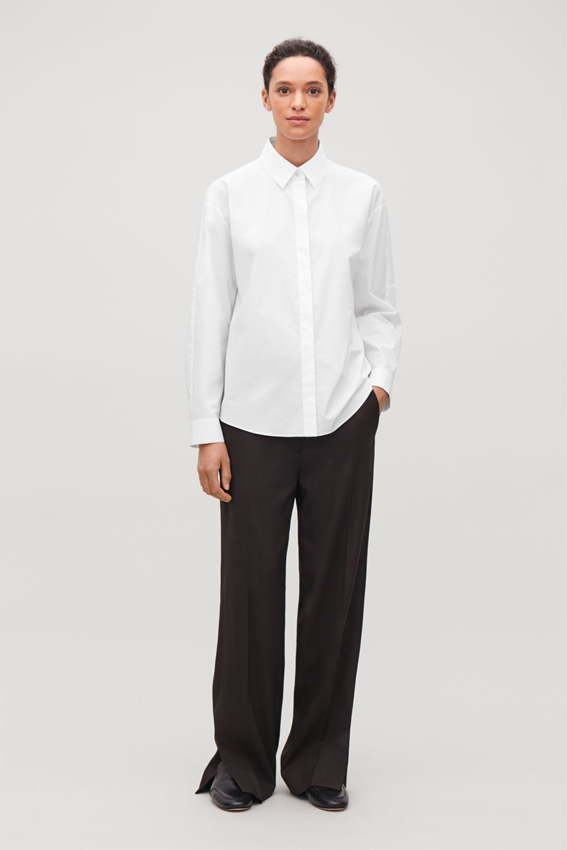 Model front image of Cos oversized cotton-poplin shirt in white