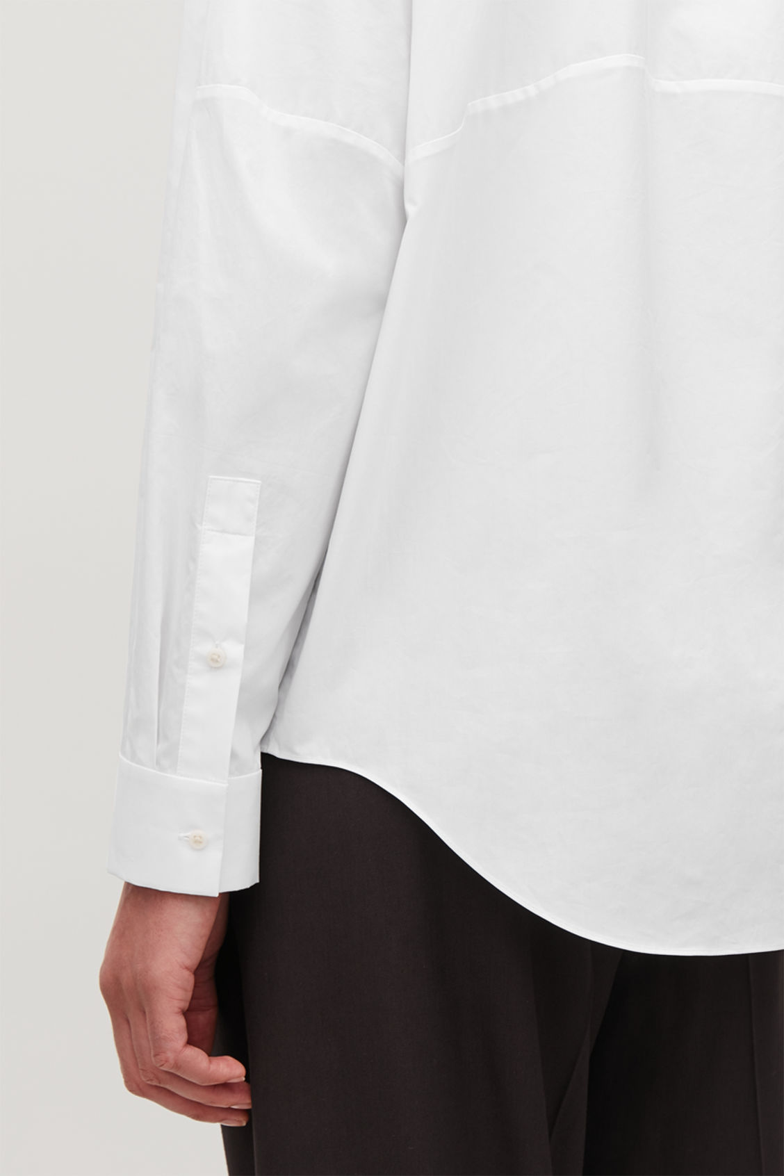 Model side image of Cos oversized cotton-poplin shirt in white