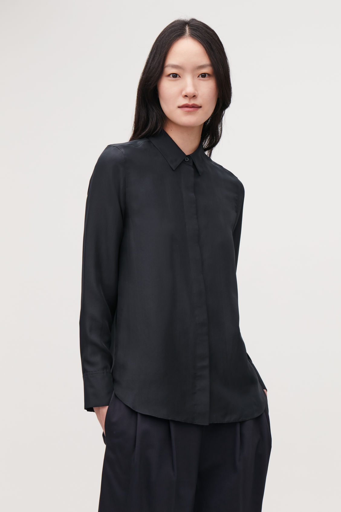 Model side image of Cos silk shirt in blue
