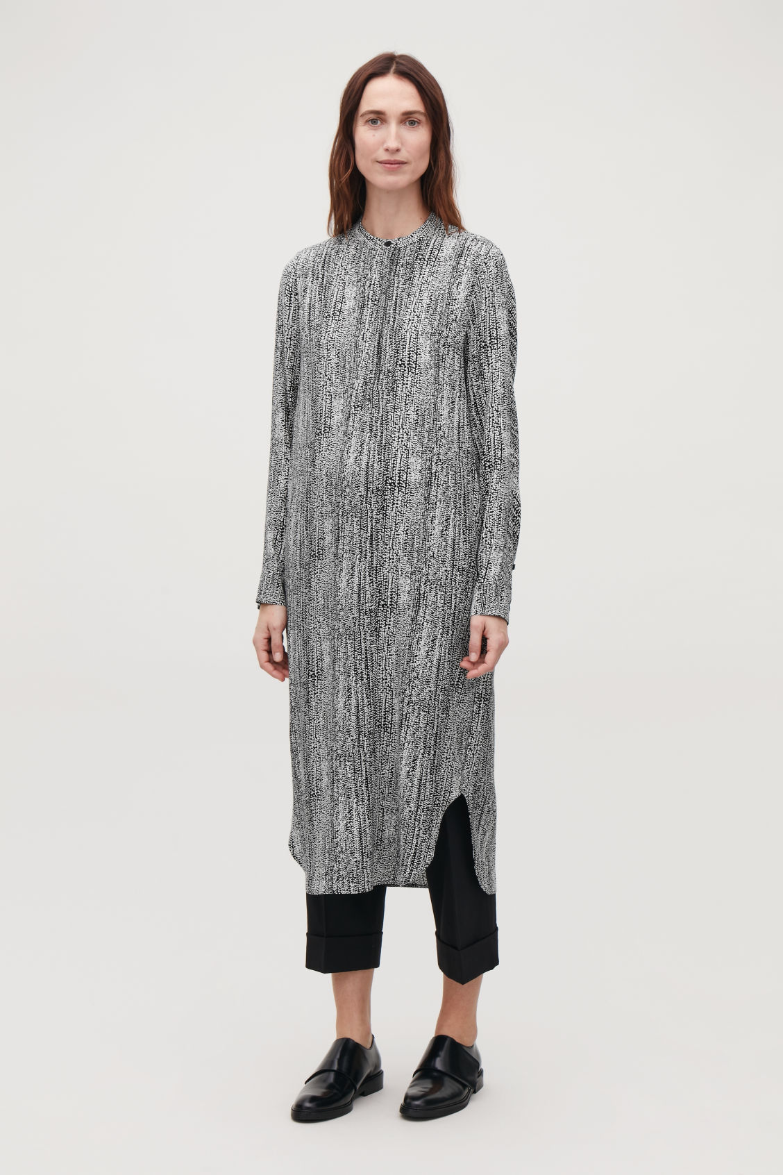 Model front image of Cos printed mid-length dress in black