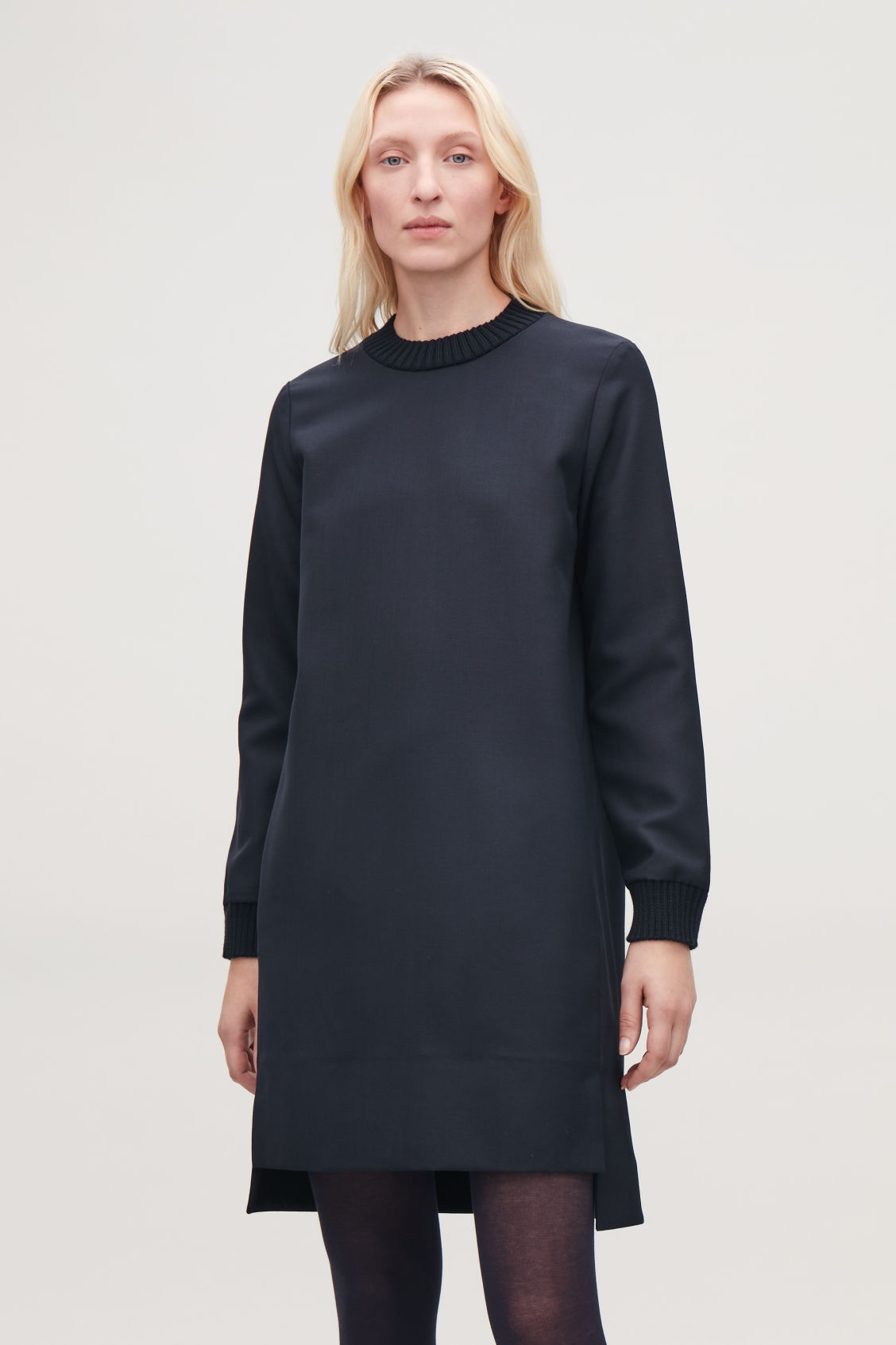 Model side image of Cos dress with knitted trims  in blue