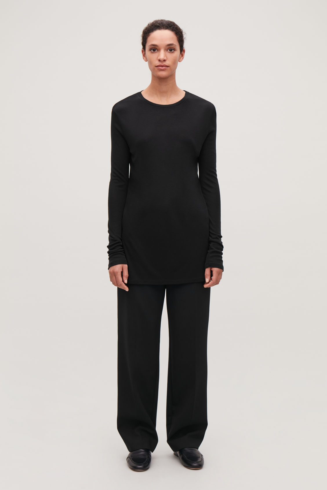 Model front image of Cos round-neck jersey top in black