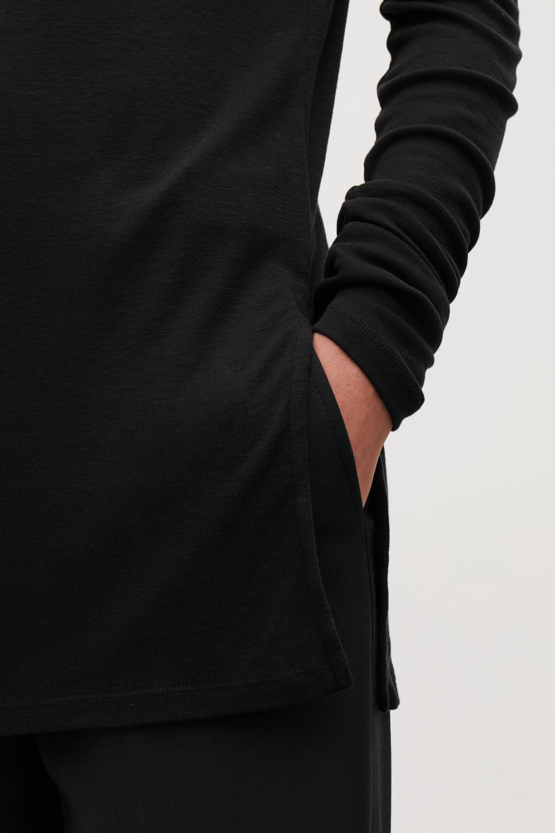 Model side image of Cos round-neck jersey top in black