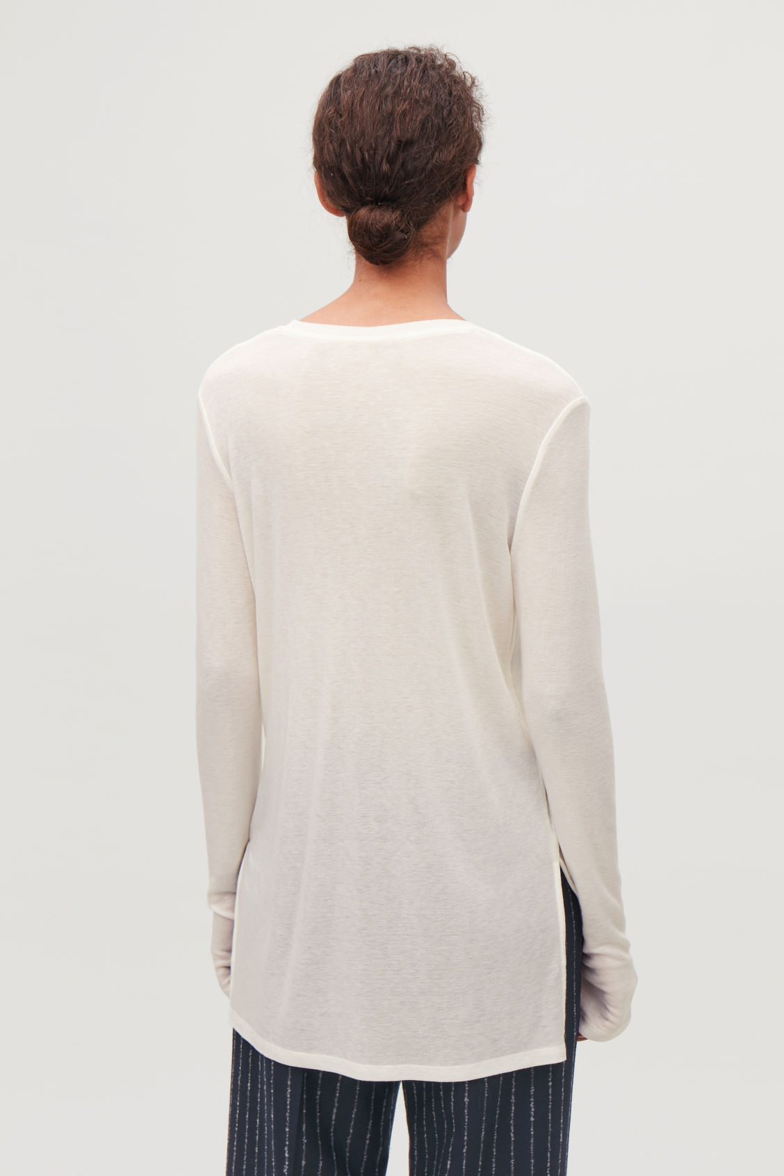 Model side image of Cos round-neck jersey top in white