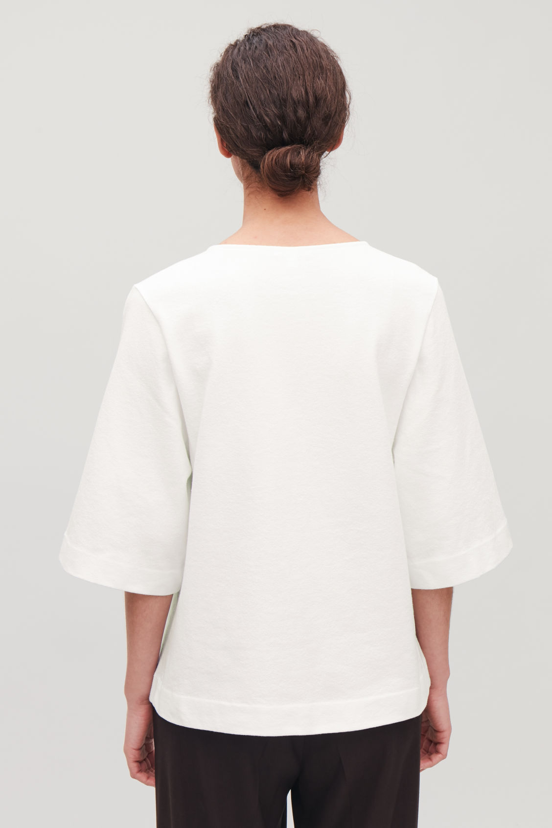 Model side image of Cos boxy cotton-boucle top  in white