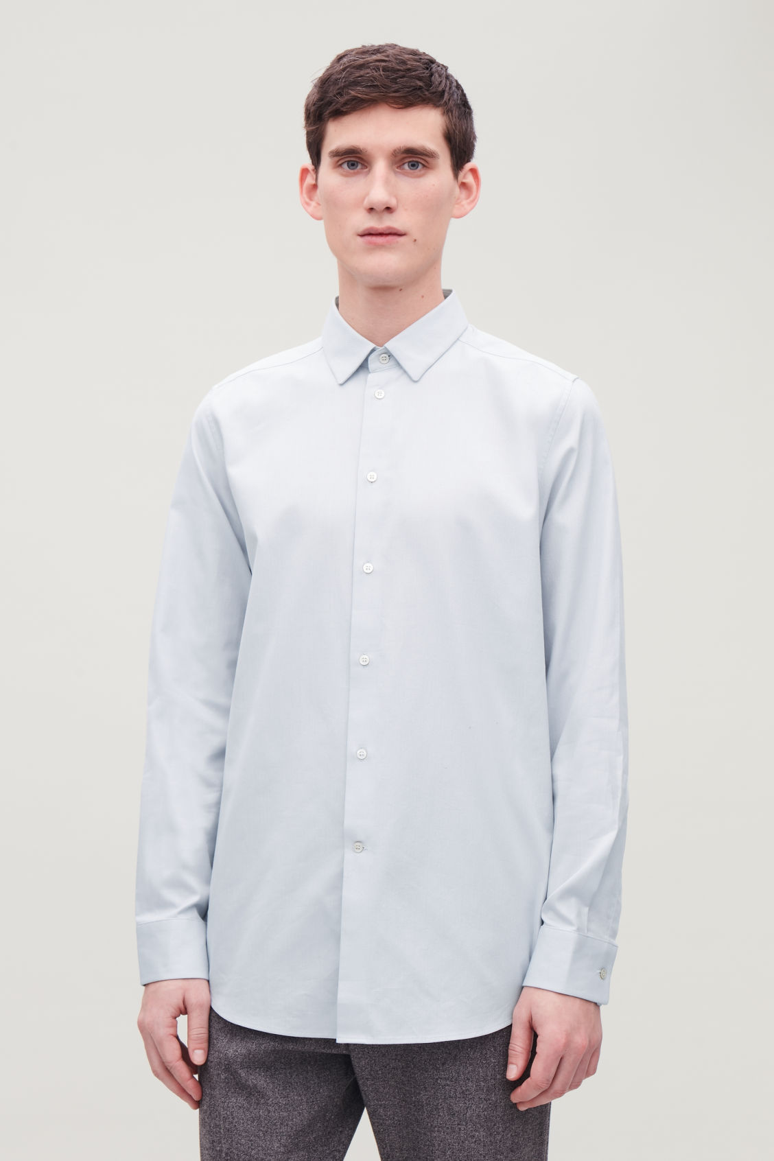Model side image of Cos structured cotton shirt in blue