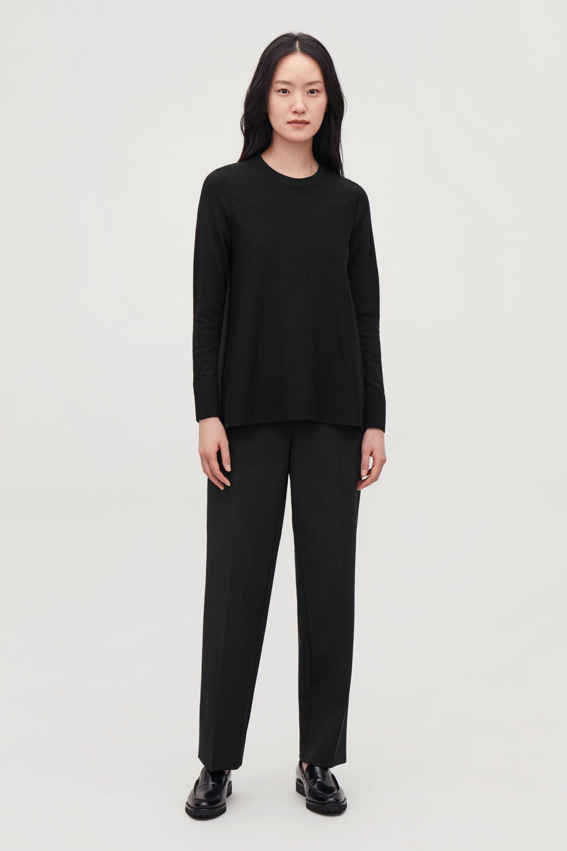 Model front image of Cos knit top with silk panel in black