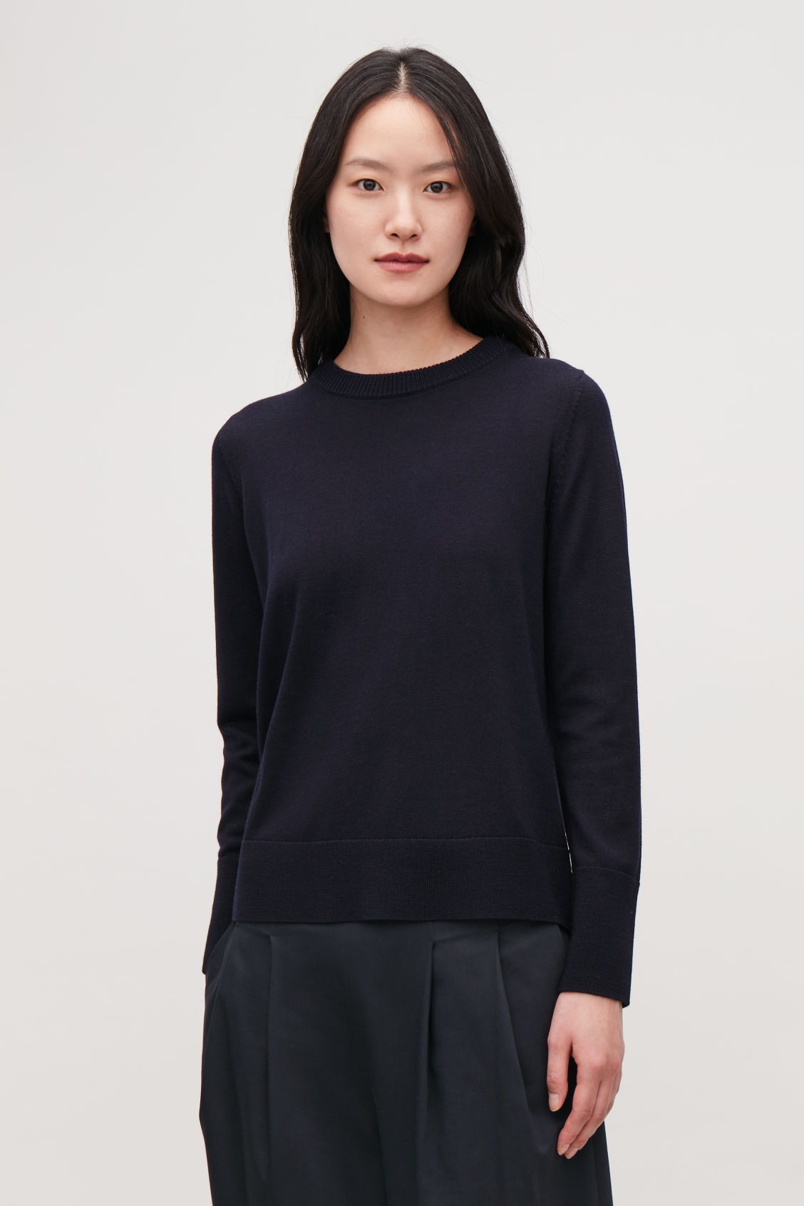Model side image of Cos mix-stitch merino jumper in blue