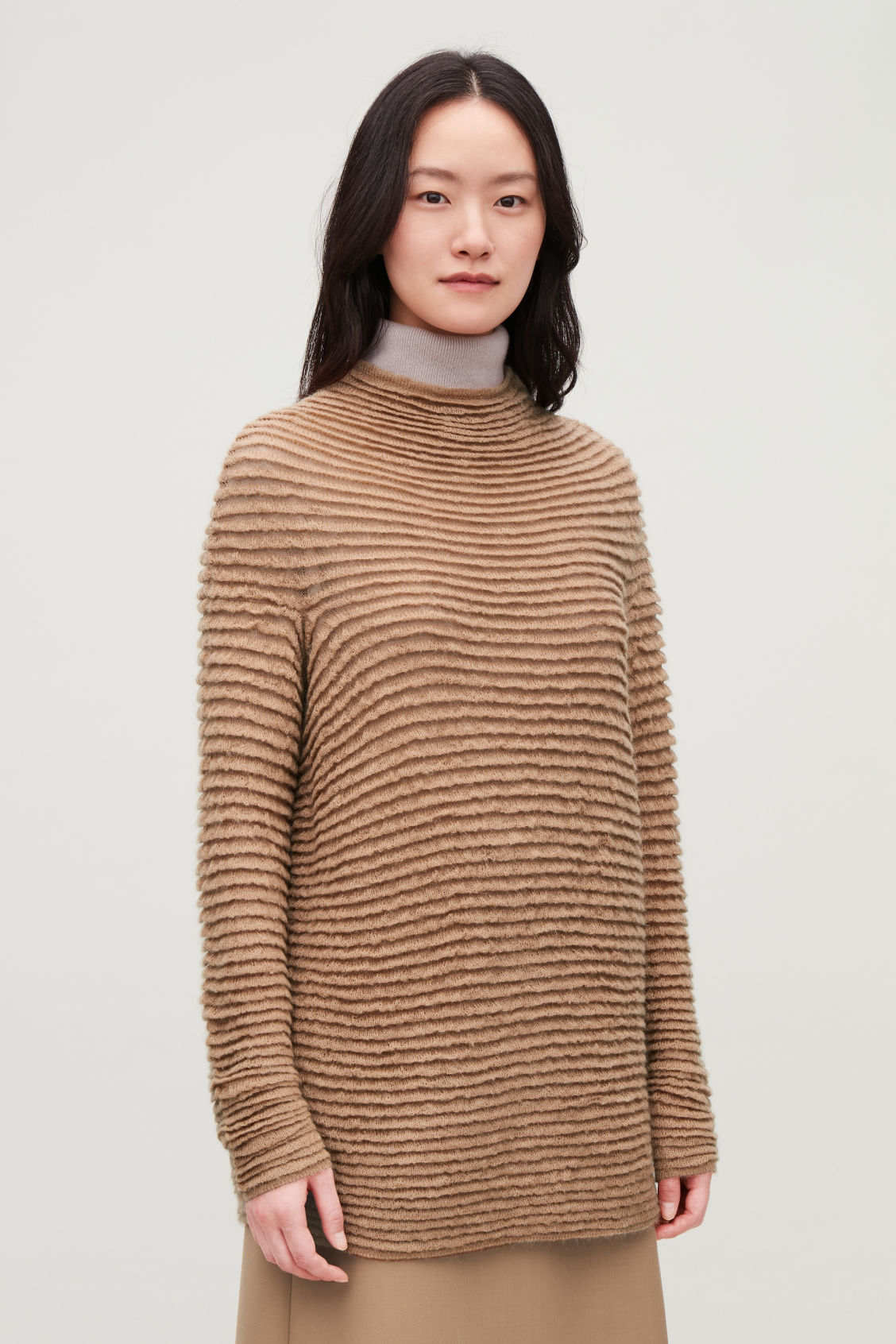 Model side image of Cos ripple-stitched wool jumper  in beige