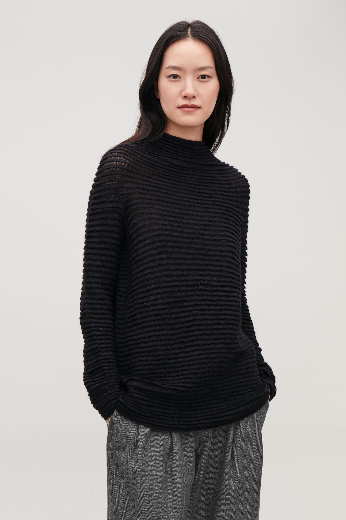 Model side image of Cos ripple-stitched mochair jumper  in black