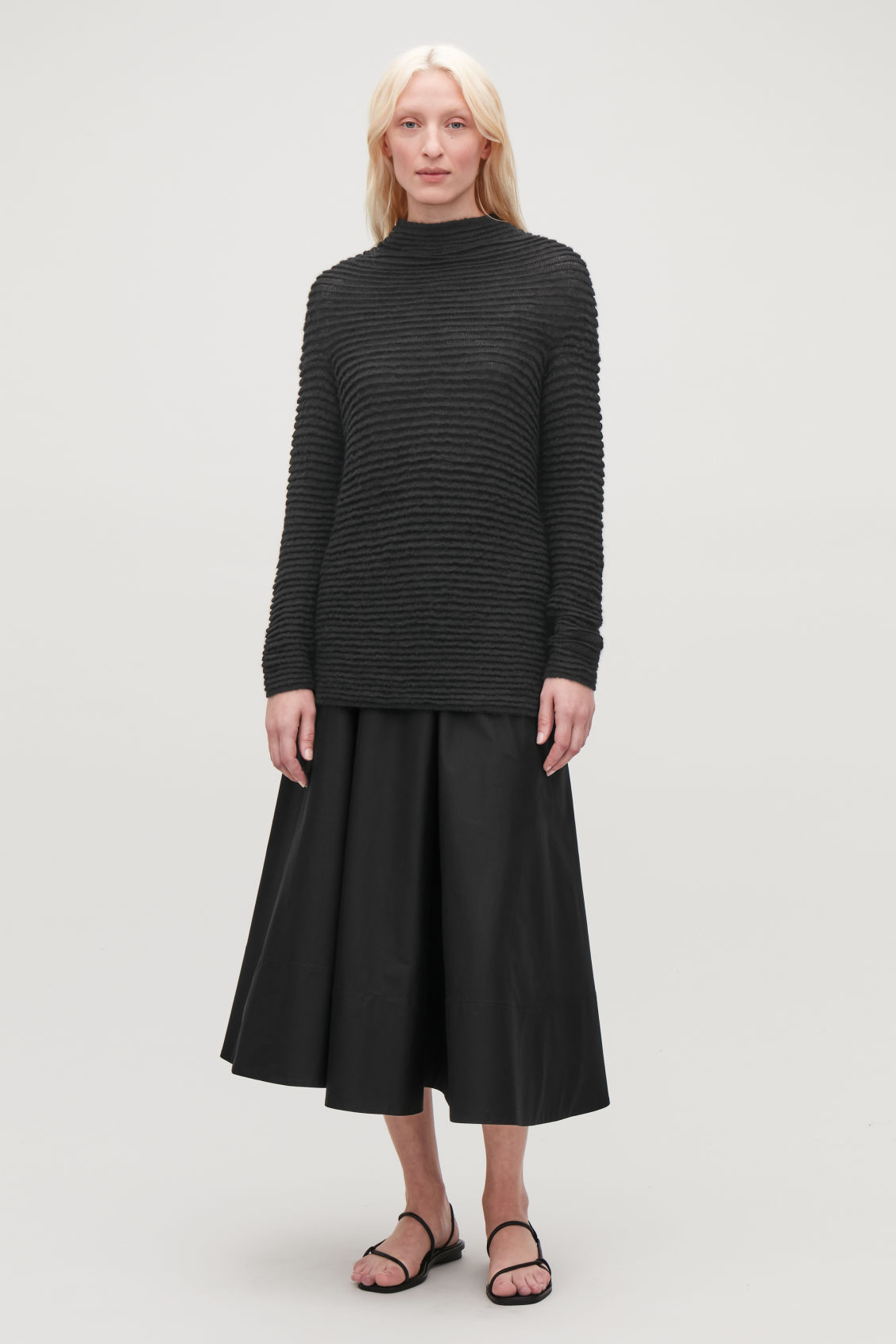 Model side image of Cos ripple-stitched wool jumper  in black