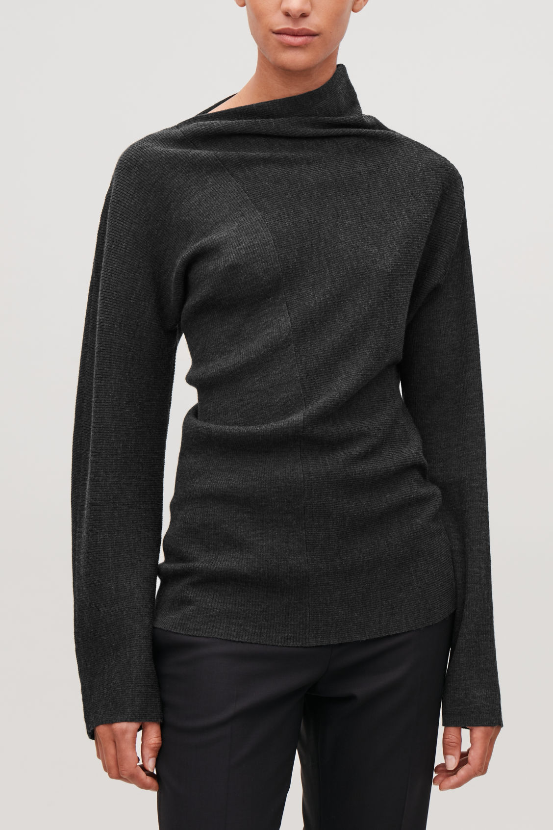 Model side image of Cos draped-neck merino jumper in grey