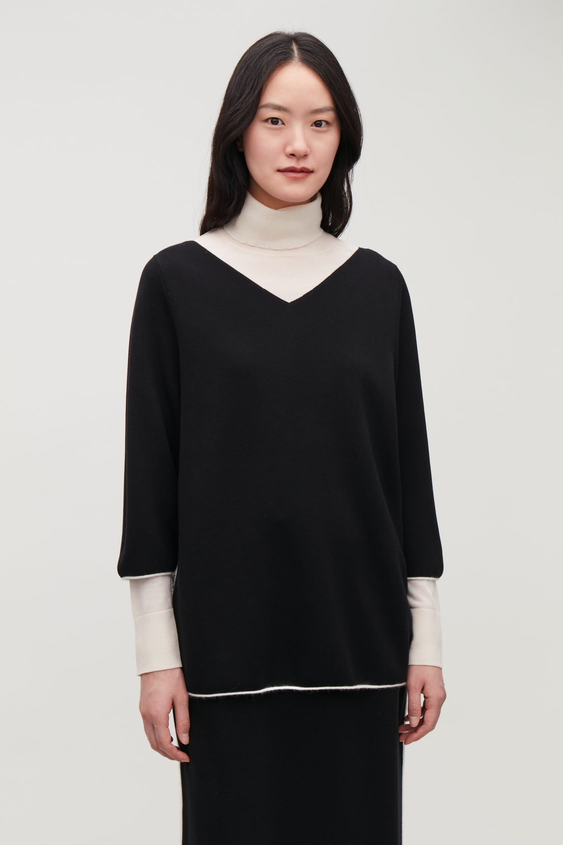 Model side image of Cos trimmed v-neck knitted top in black