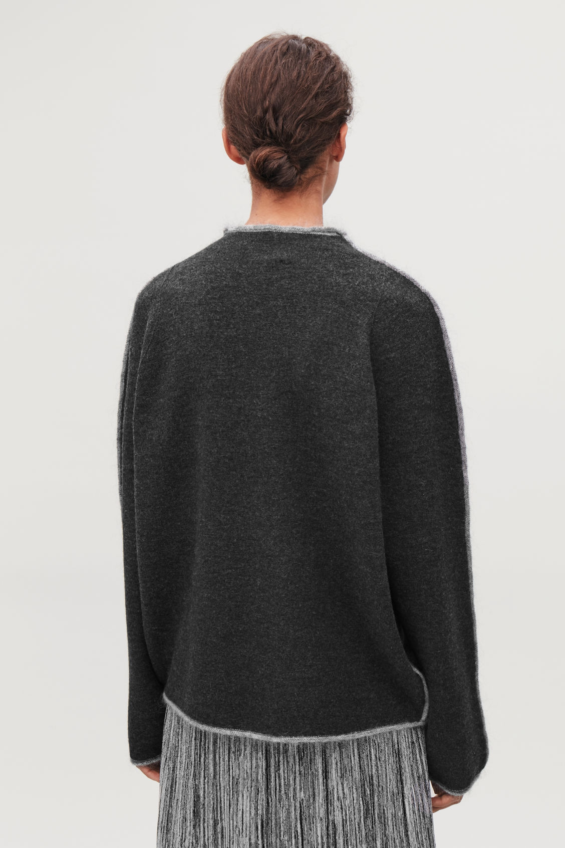 Model side image of Cos trimmed boiled-wool jumper  in grey