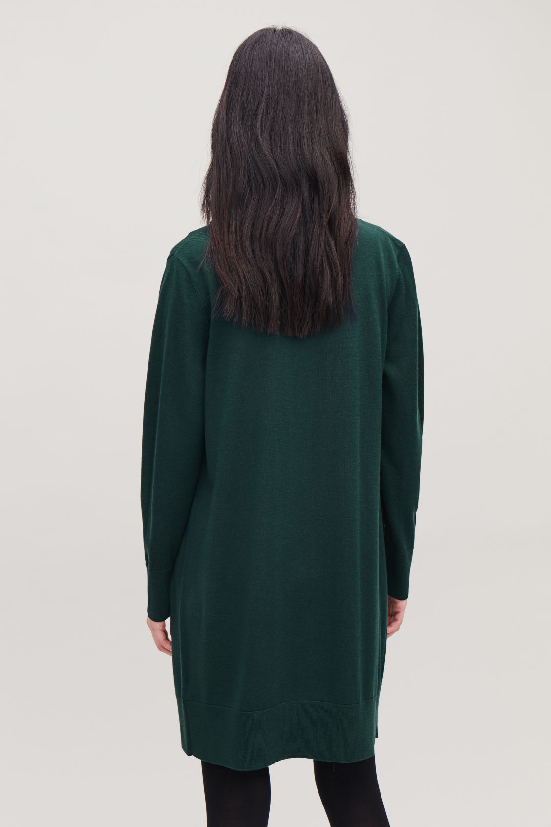 Model side image of Cos button-up merino wool dress in green
