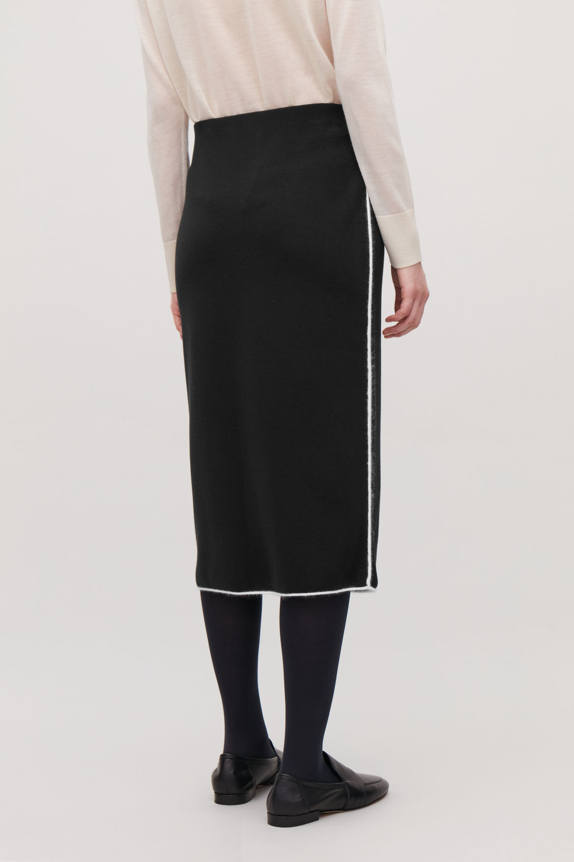 Model side image of Cos trimmed knit pencil skirt in black