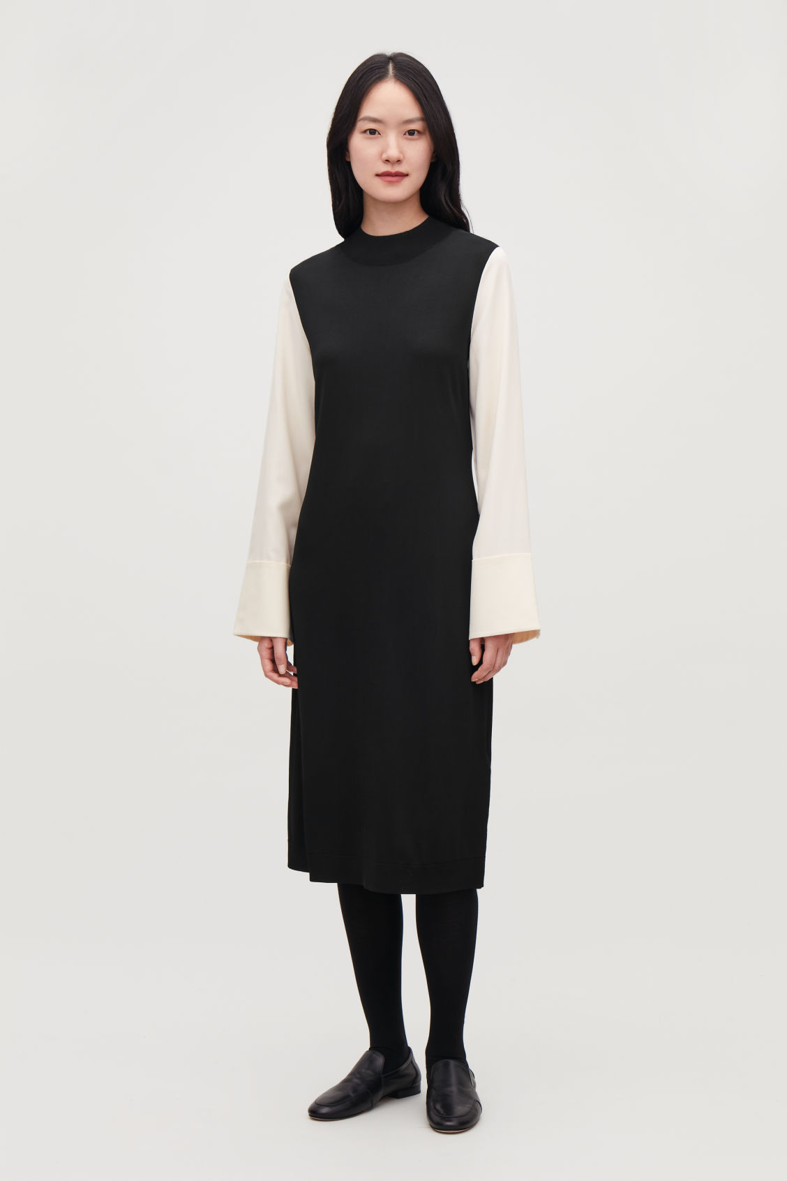 Model front image of Cos silk-sleeved knit dress in black
