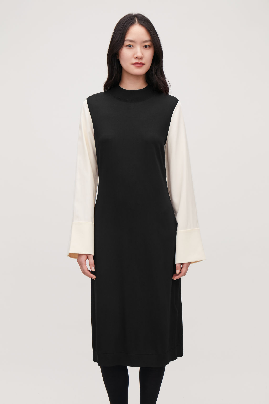 Model side image of Cos silk-sleeved knit dress in black