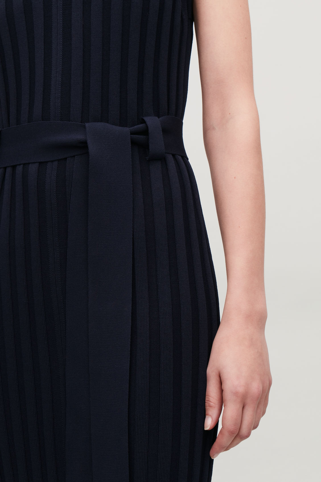 Model side image of Cos sleeveless ribbed dress in blue