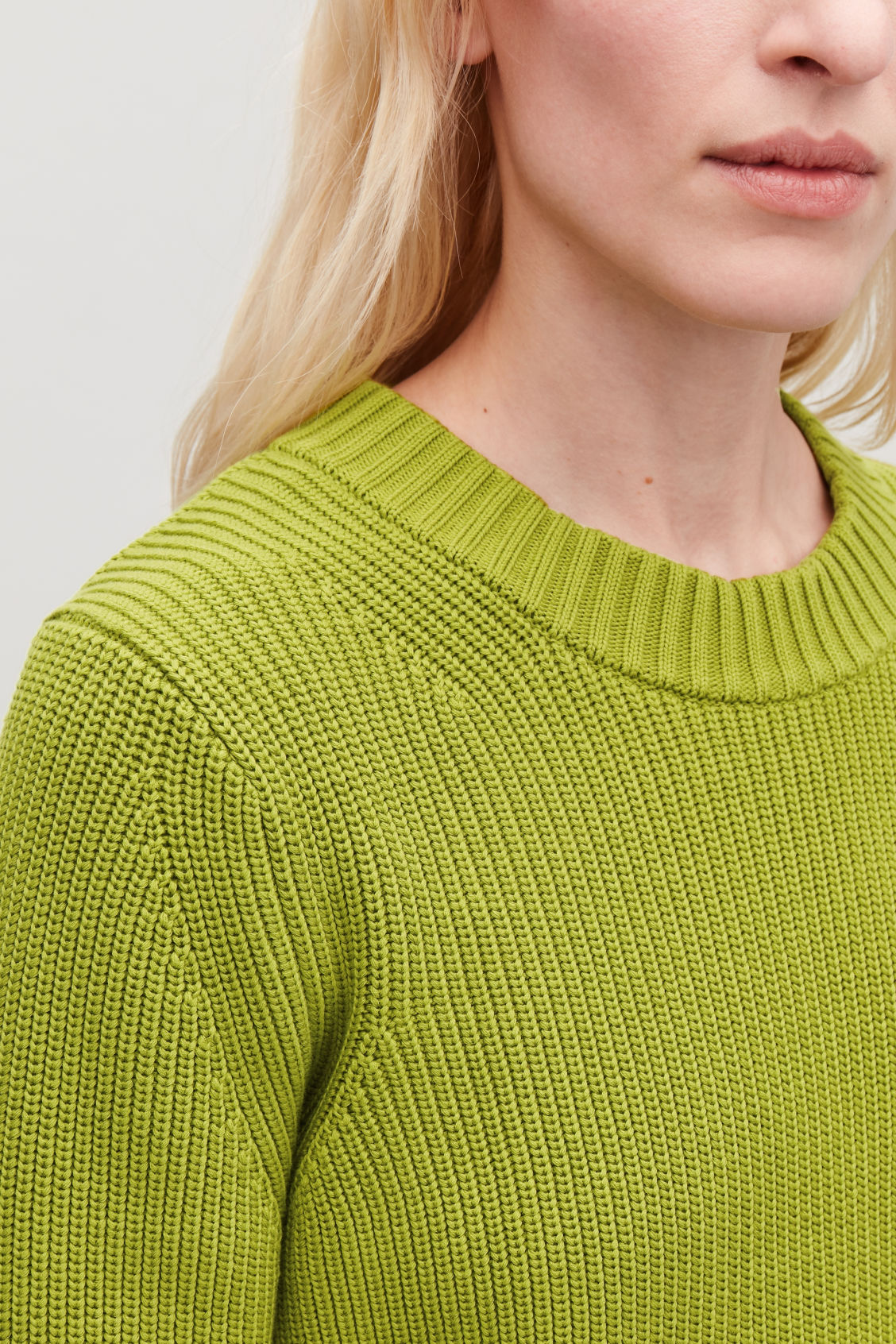 Model side image of Cos chunky-knit jumper in green